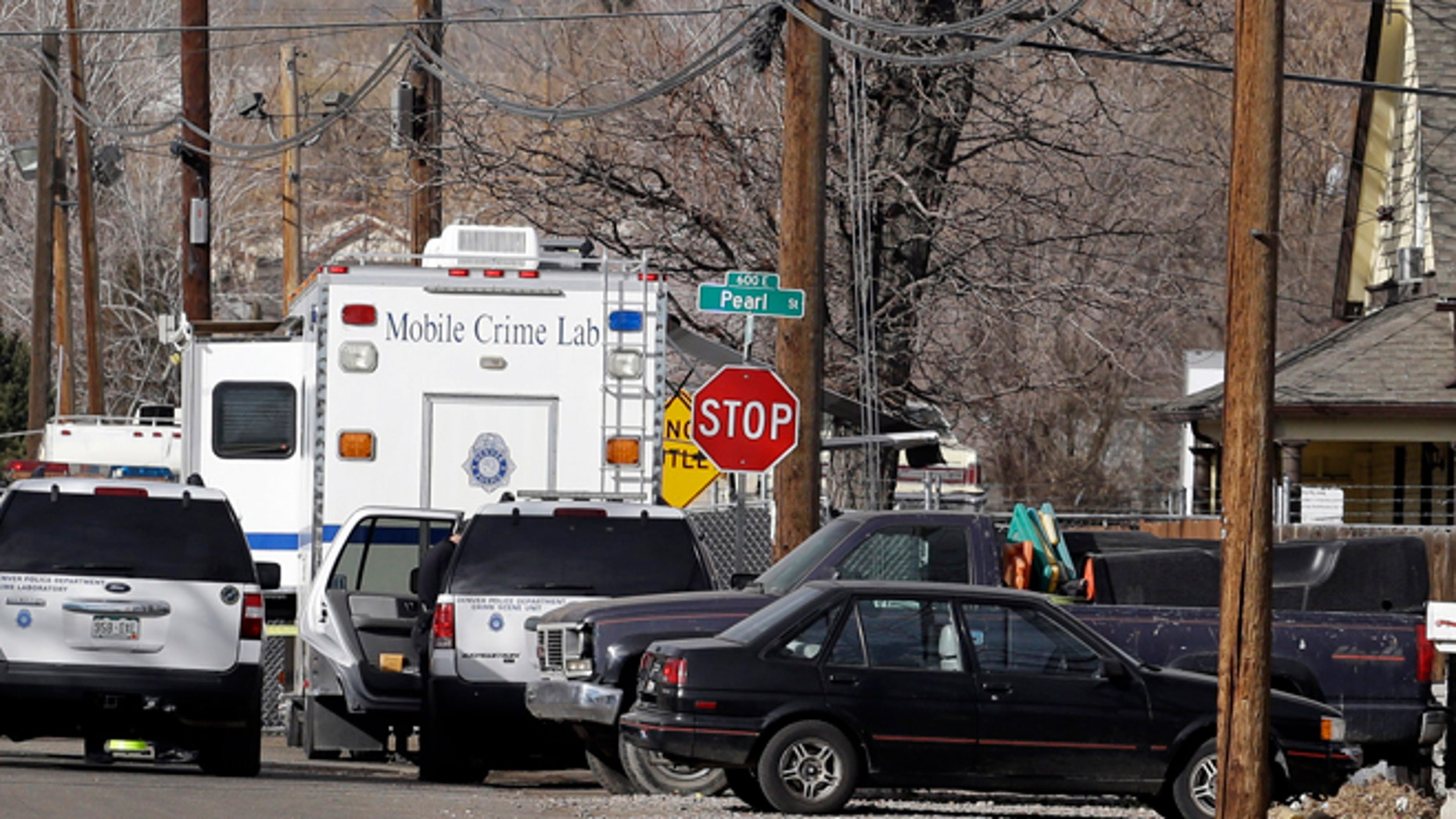 Feb. 6, 2013: Police investigate the scene of a shooting where a woman and two children were found dead and a third child wounded in the Globeville neighborhood in Denver.