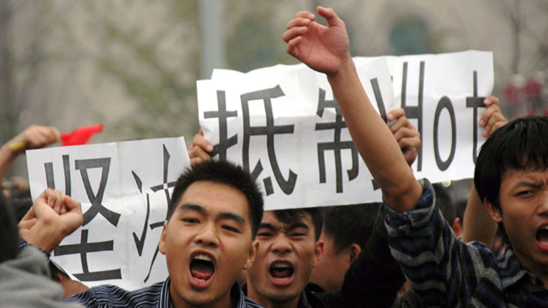 Anti-Japan protesters march with cards calling for a boycott of Japanese products in Wuhan in central China's Hubei province Monday, Oct. 18, 2010. Thousands of Chinese have marched in different Chinese cities in sometimes violent protests since Saturday against Japan and its claim to disputed islands, a show of anger far larger than past protests over the competing territorial claims.