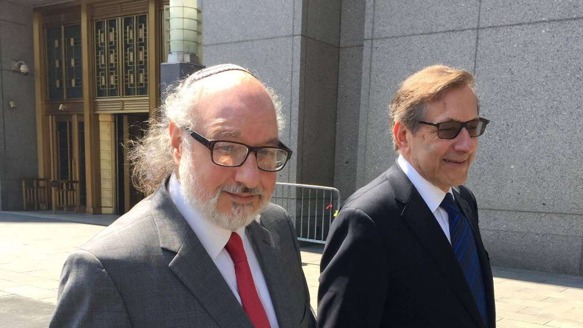 In this July 22, 2016 file photo, convicted spy Jonathan Pollard, left, with his lawyer, Eliot Lauer, leave federal court in New York following a hearing. On Thursday, Aug. 11, U.S. District Judge Katherine Forrest refused to ease the conditions of Pollard's parole. In her written ruling, Forrest said that the Parole Commission did not abuse its discretion when it imposed the restrictions. (AP Photo/Larry Neumeister, File)In this July 22, 2016 file photo, convicted spy Jonathan Pollard, left, with his lawyer, Eliot Lauer, leave federal court in New York following a hearing.