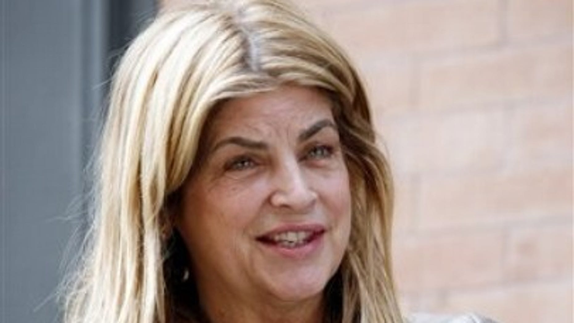 Actress Kirstie Alley talks to the media as she arrives at a building next to the house on Franklin St. in the Tribeca neighborhood of Manhattan where International Monetary Fund leader Dominique Strauss-Kahn is staying under house arrest Saturday, May 28,  2011.  (AP Photo/David Karp)