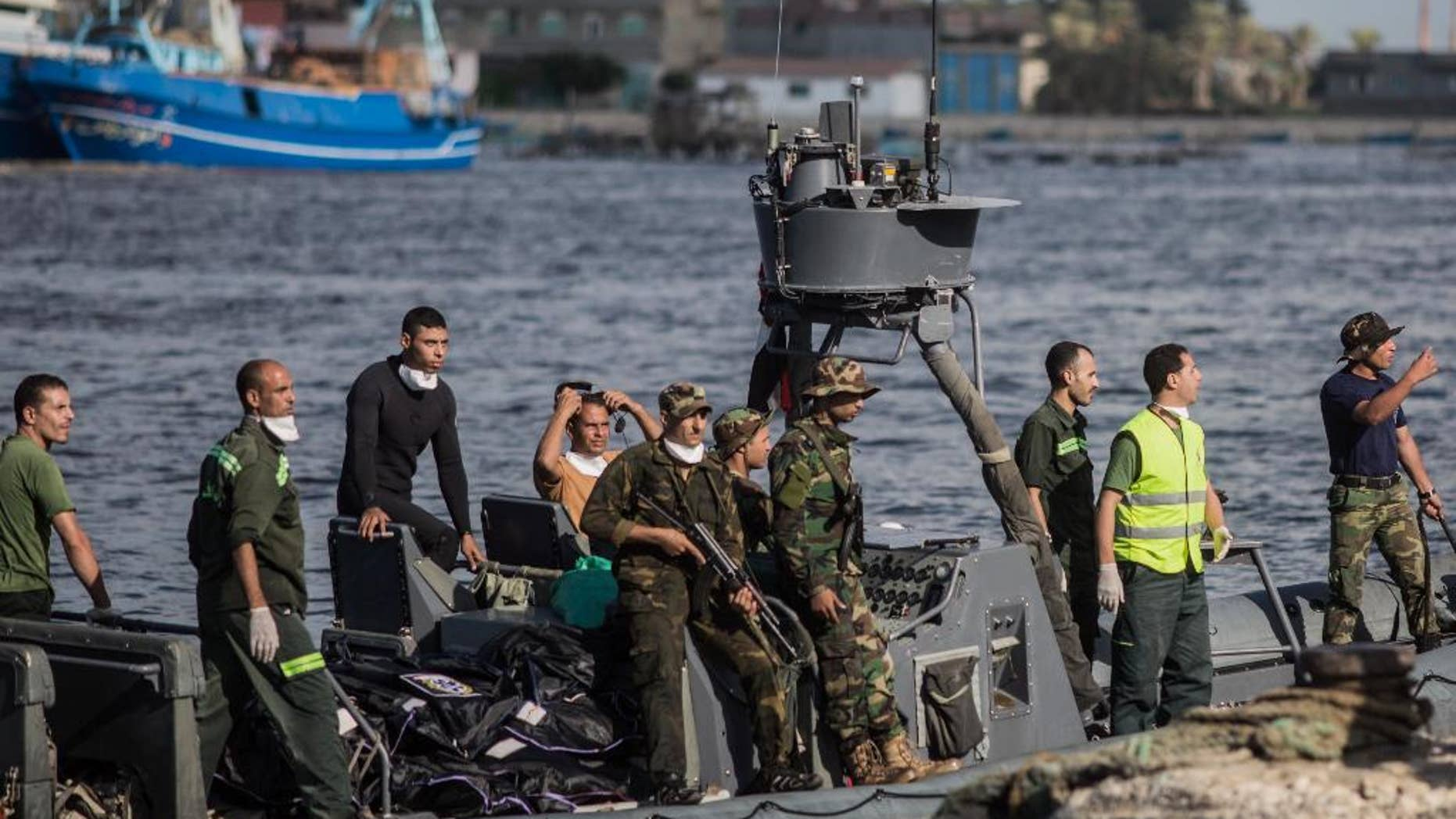 Sept. 22, 2016: Egyptian coast guard and rescue workers bring ashore bodies recovered from a Europe-bound boat that capsized off Egypt's Mediterranean coast, in Rosetta, Egypt.