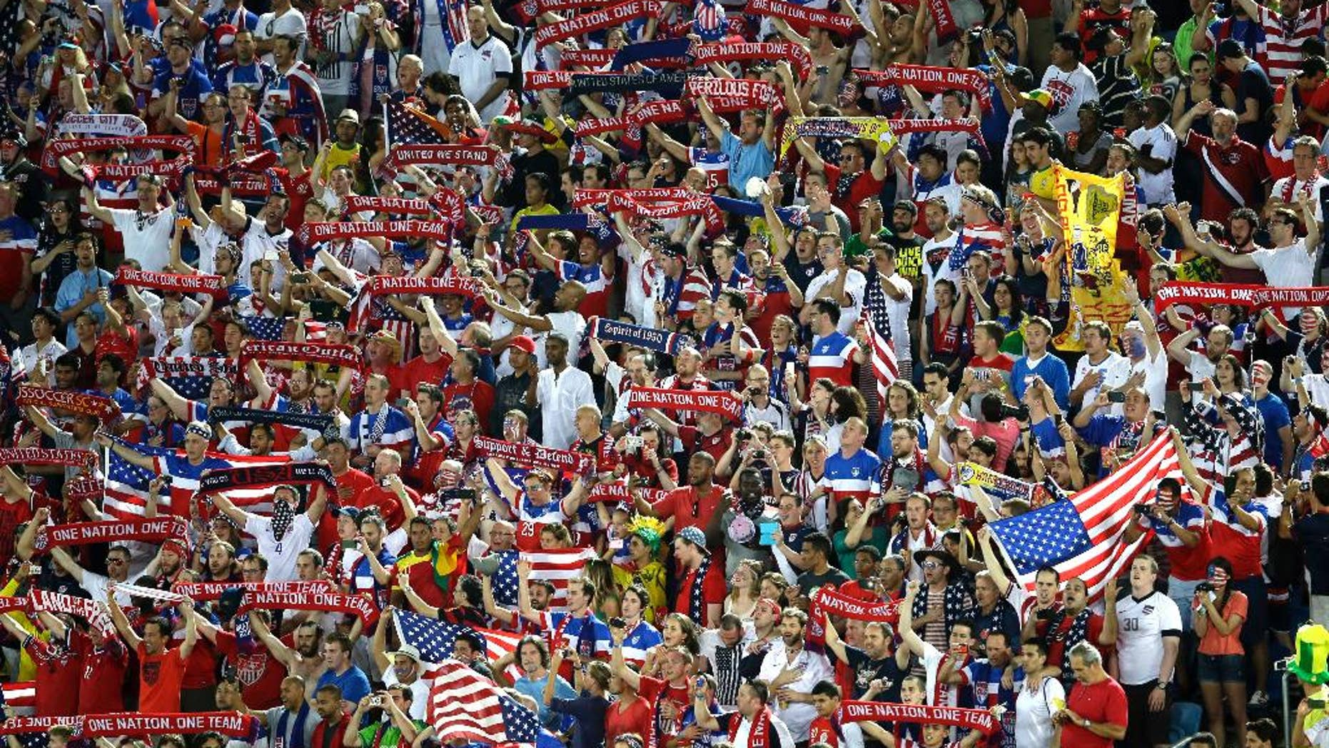 United States fans hold scarfs prior to the group G World Cup soccer match between Ghana and the United States at the Arena das Dunas in Natal, Brazil, Monday, June 16, 2014. (AP Photo/Hassan Ammar)