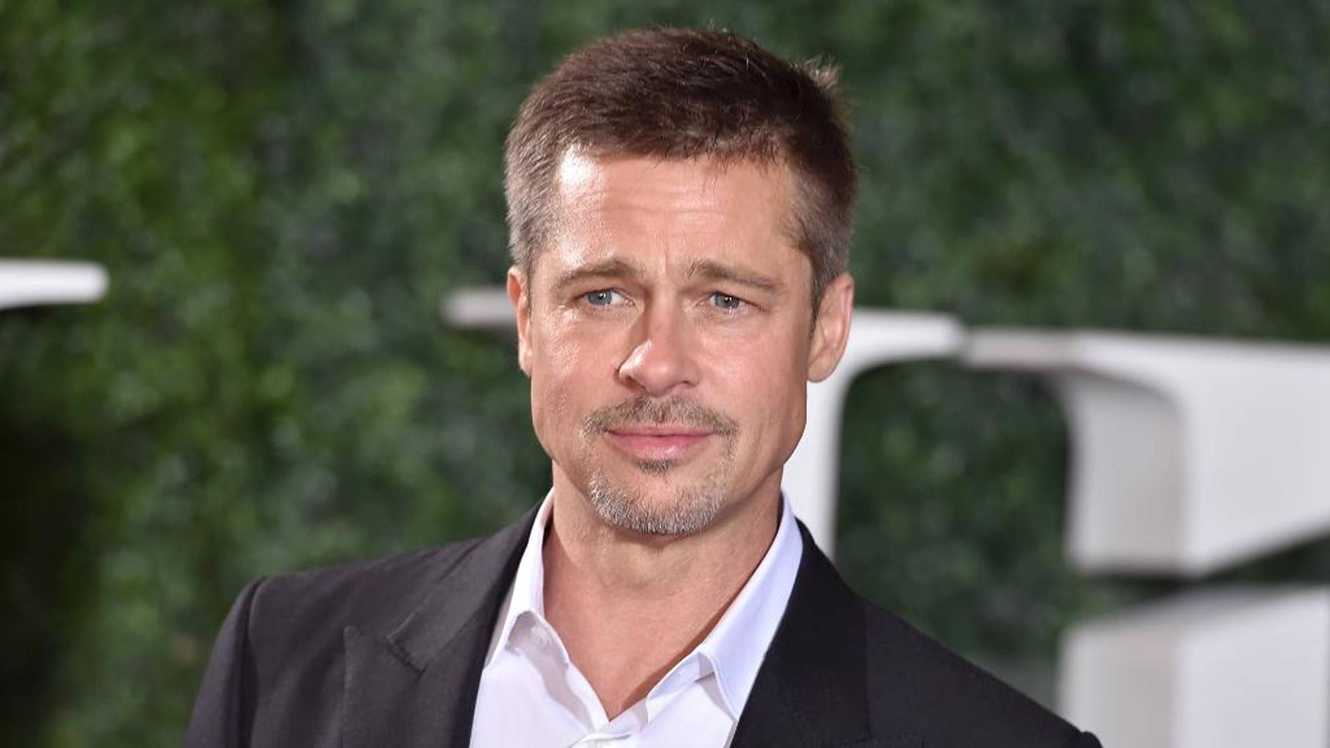 """FILE - In this Nov. 9, 2016 file photo, Brad Pitt arrives at the Los Angeles premiere of """"Allied."""" Pitt stars in the new film, """"War Machine,"""" in which he plays a slightly fictionalized version of Gen. Stanley McChrystal. (Photo by Jordan Strauss/Invision/AP, File)"""