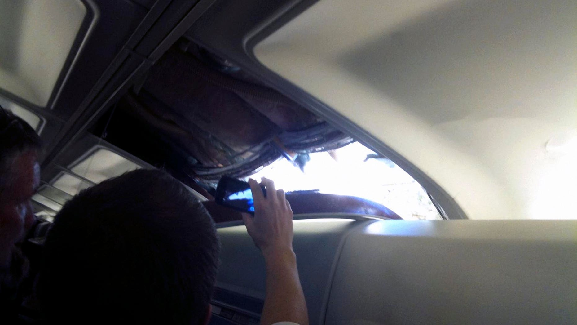 April 1: A passenger photo taken with a cell phone shows a hole in the cabin on a Southwest Airlines aircraft.