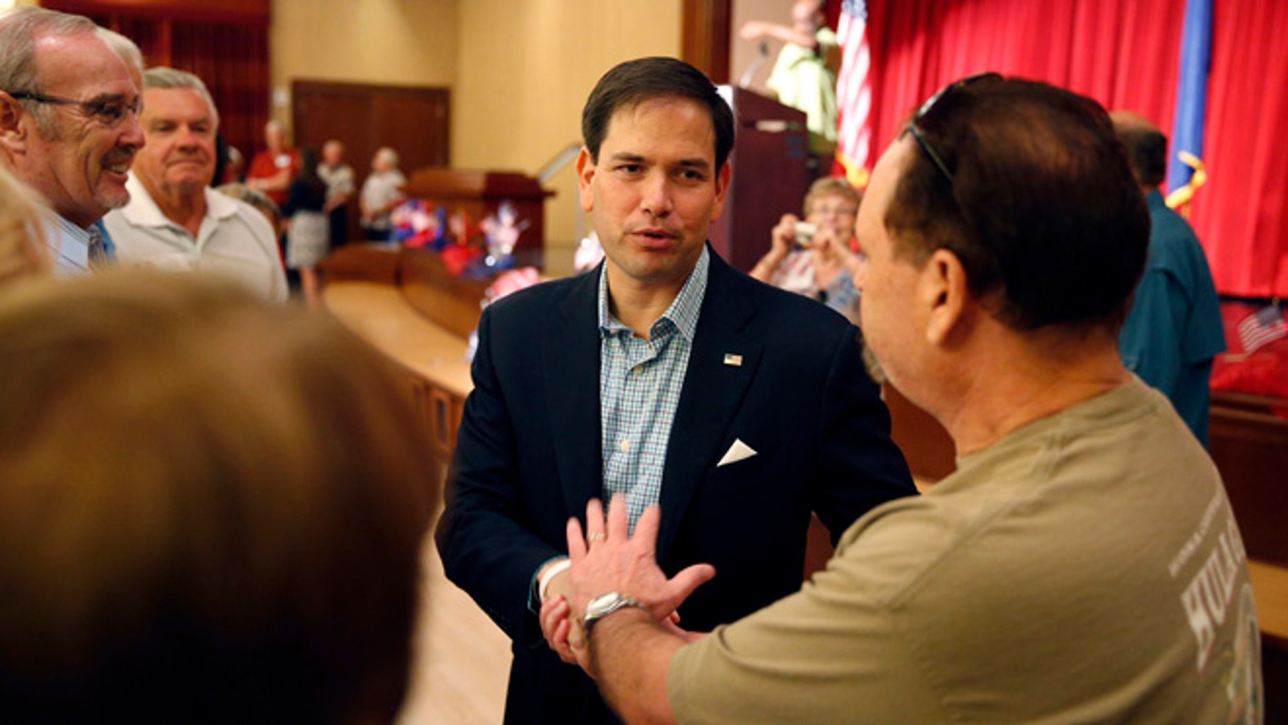 Republican presidential candidate Sen. Marco Rubio, R-Fla., shakes hands during a campaign event Saturday, July 11, 2015, in Henderson, Nev. (AP Photo/John Loche20