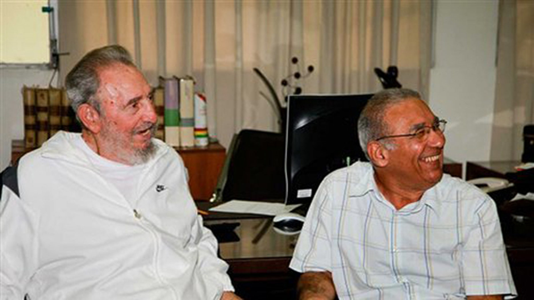 In this image released on Saturday July 10, 2010 by the state media Cubadebate website, Cuban leader Fidel Castro sits next to an unidentified man during a visit to the National Center for Scientific Investigation in Havana last July 7, 2010.