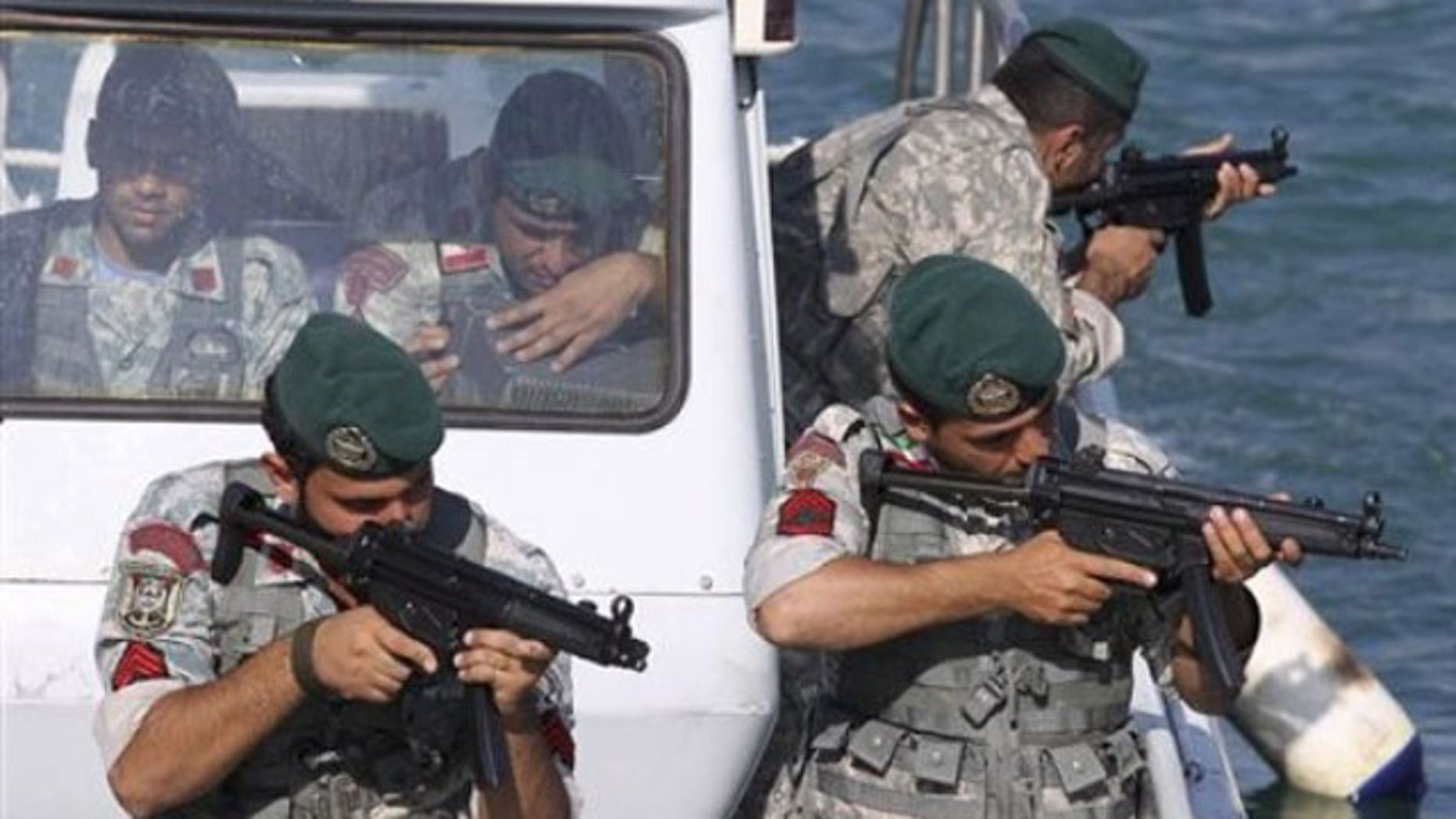 December 28, 2011: Iranian navy members take positions during a drill in the Sea of Oman.