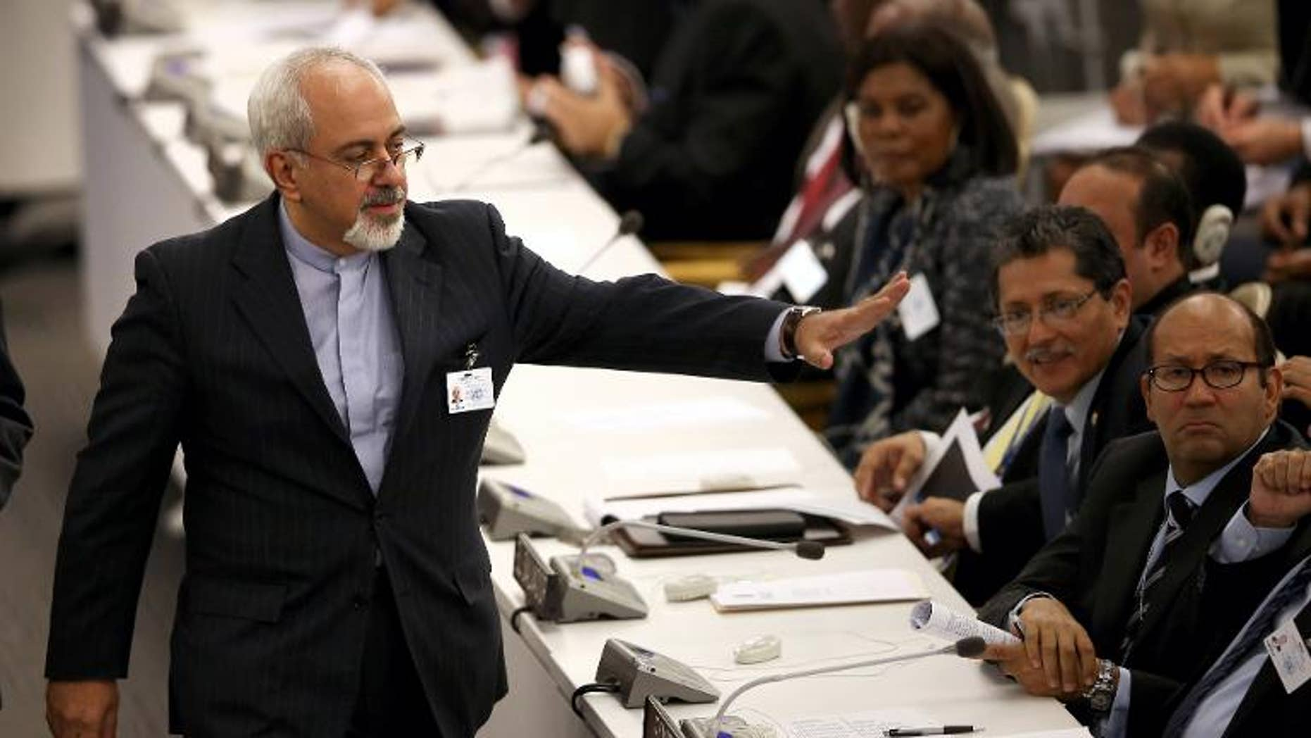 Iranian Foreign Minister Mohammad Javad Zarif greets fellow diplomats after listening to US President Barack Obama address the UN General Assembly on September 24, 2013 in New York