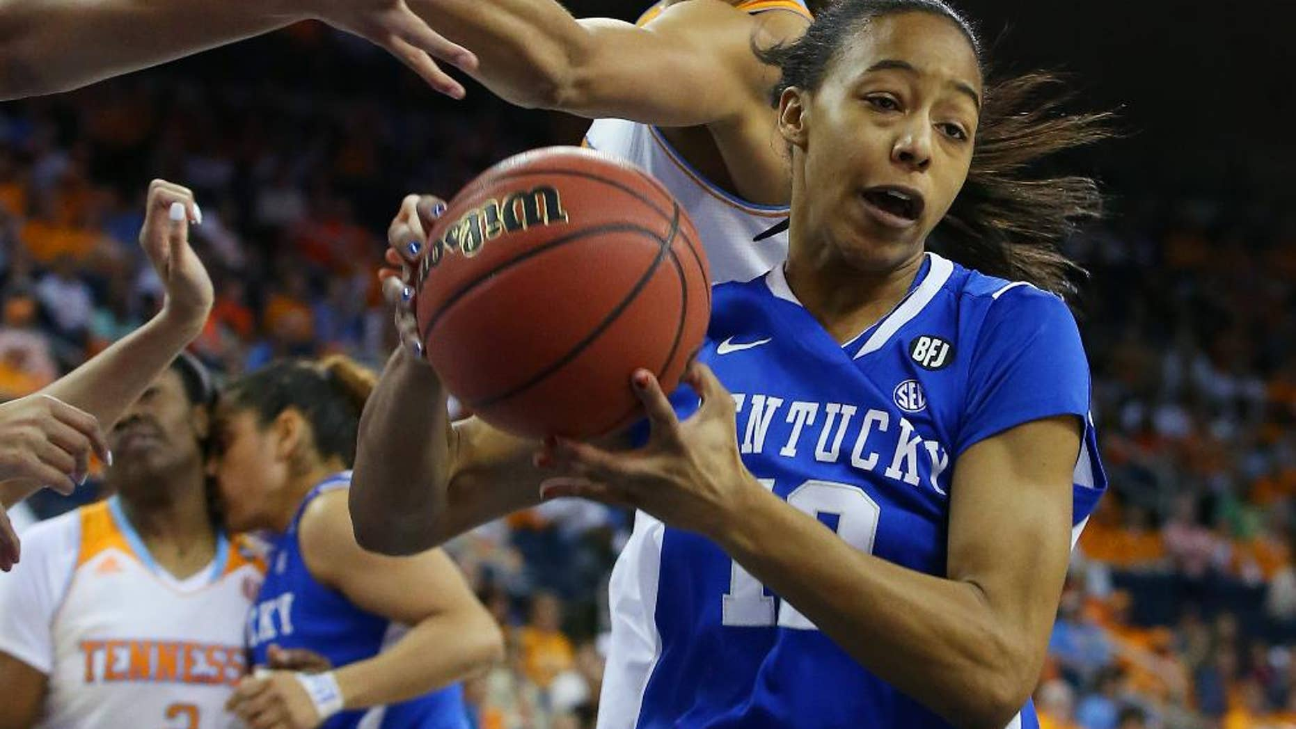 Kentucky forward/center Jelleah Sidney (12) rebounds in front of Tennessee center Isabelle Harrison, top, in the first half of an NCAA college basketball game in the finals of the Southeastern Conference women's tournament on Sunday, March 9, 2014, in Duluth, Ga. (AP Photo/Jason Getz)