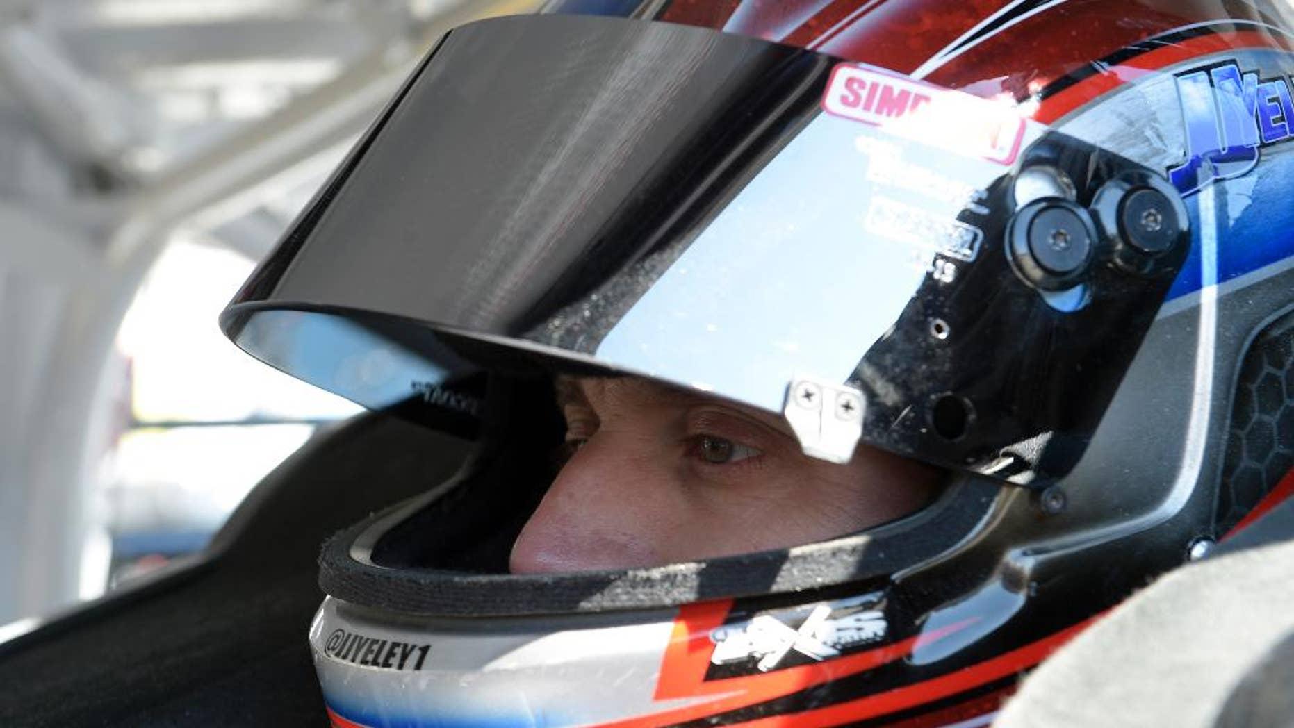 J.J. Yeley sits in his car before practice for the Daytona 500 NASCAR Sprint Cup series auto race at Daytona International Speedway in Daytona Beach, Fla., Thursday, Feb. 19, 2015. (AP Photo/Phelan M. Ebenhack)