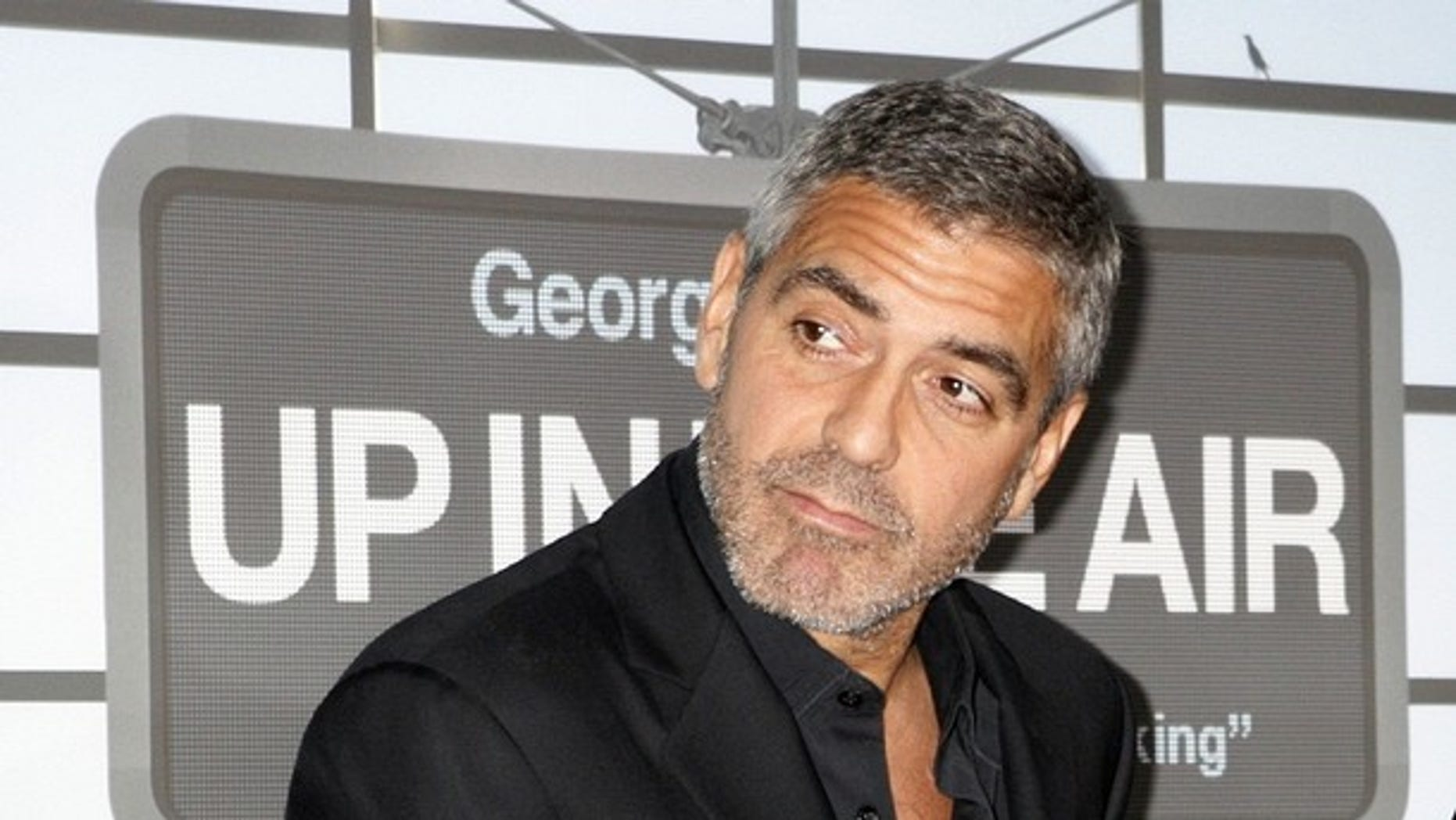 """Actor George Clooney, star of the film """"Up in the Air"""" poses on the red carpet at the film's premiere in Los Angeles (REUTERS)"""