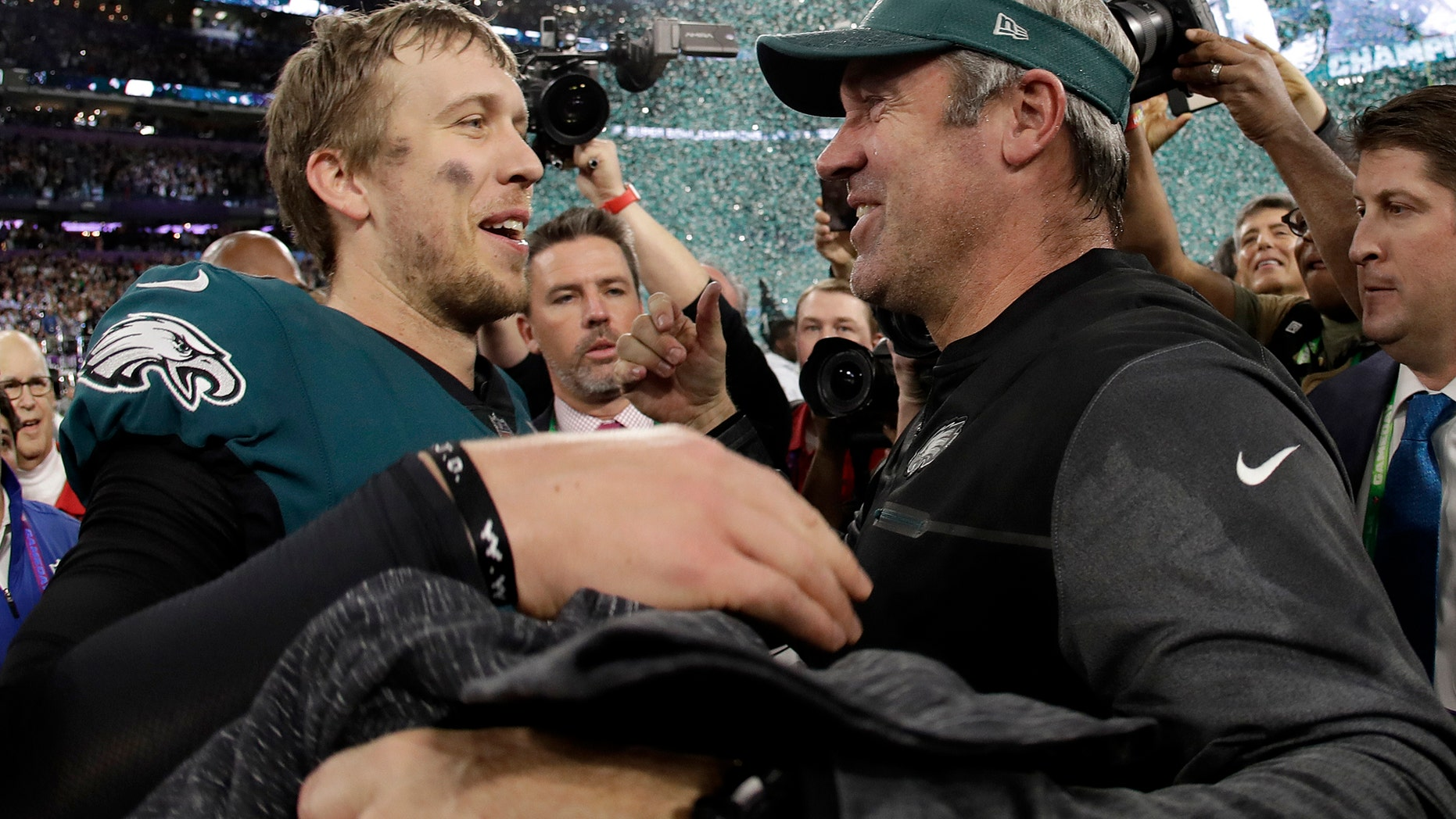 Philadelphia Eagles' Nick Foles, left, celebrates with head coach Doug Pederson after the NFL Super Bowl 52 football game against the New England Patriots Sunday, Feb. 4, 2018, in Minneapolis. The Eagles won 41-33. (AP Photo/Matt Slocum)