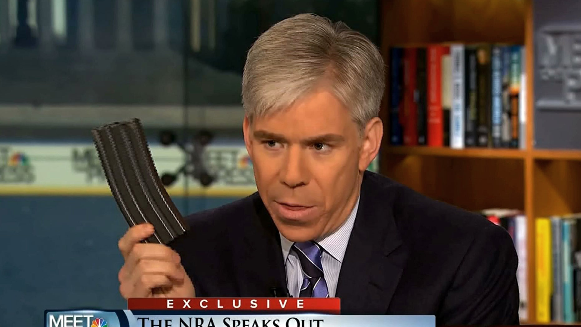 """This image made from video provided by NBC's """"Meet the Press"""" shows host David Gregory holding what he described as a high-capacity ammunition magazine during the taping of the Sunday, Dec. 23, 2012 program. He was interviewing National Rifle Association executive vice president Wayne LaPierre and used the magazine as a prop while discussing gun control. Gregory won't face charges for possession of a high-capacity magazine D.C. prosecutors announced Friday, Jan. 11, 2013 saying criminal charges wouldn't serve the public's best interests. (AP Photo/Meet the Press)"""