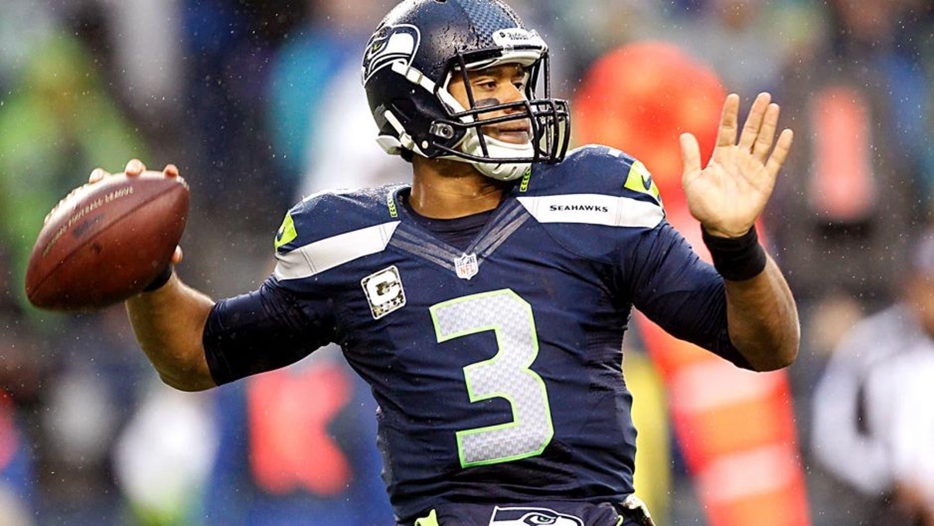 Nov 17, 2013; Seattle, WA, USA; Seattle Seahawks quarterback Russell Wilson (3) passes against the Minnesota Vikings during the second half at CenturyLink Field. Mandatory Credit: Joe Nicholson-USA TODAY Sports