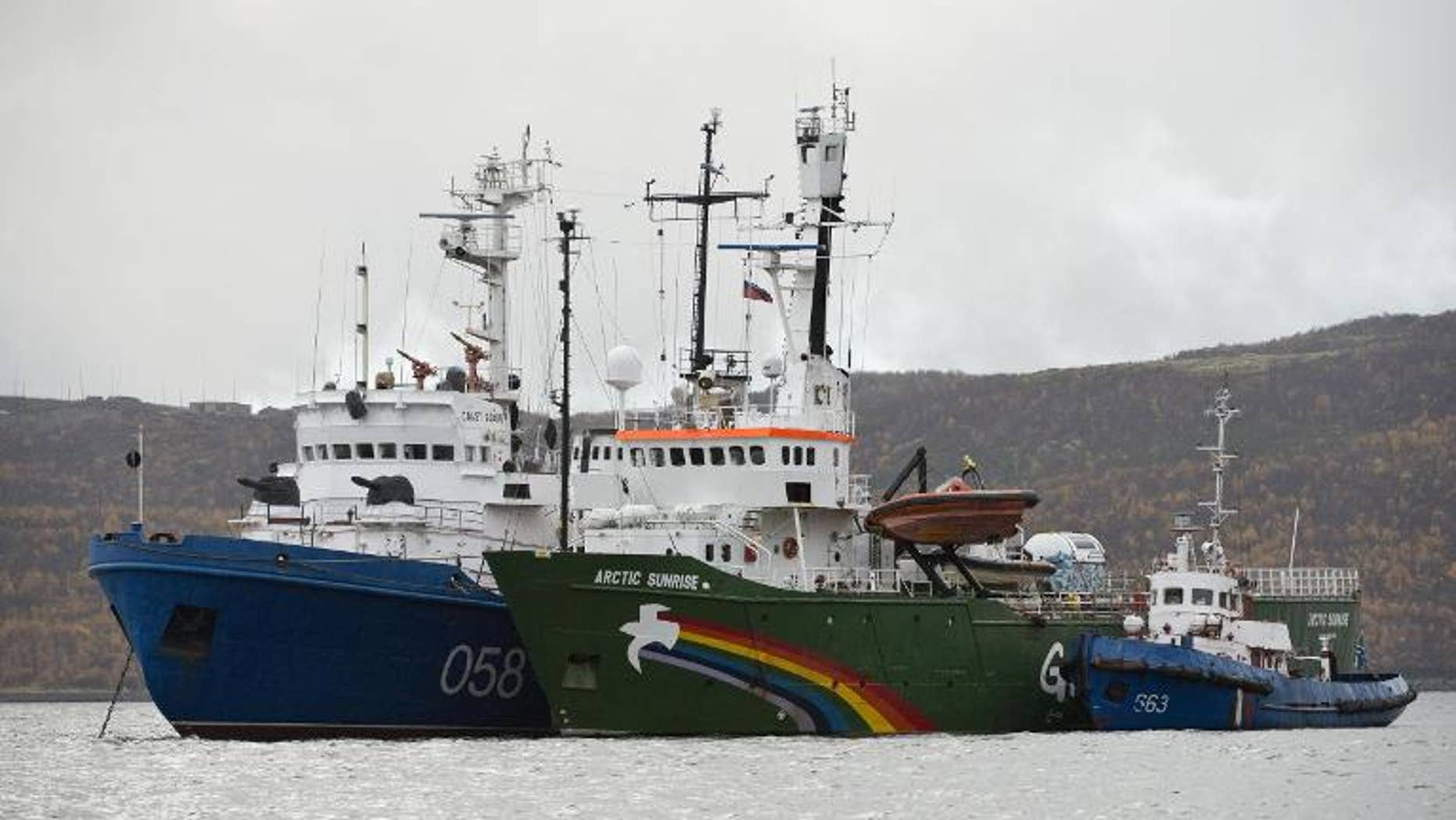 Picture released on September 28, 2013 by Greenpeace International shows the Greenpeace International ship, Arctic Sunrise (C), in Murmansk harbour