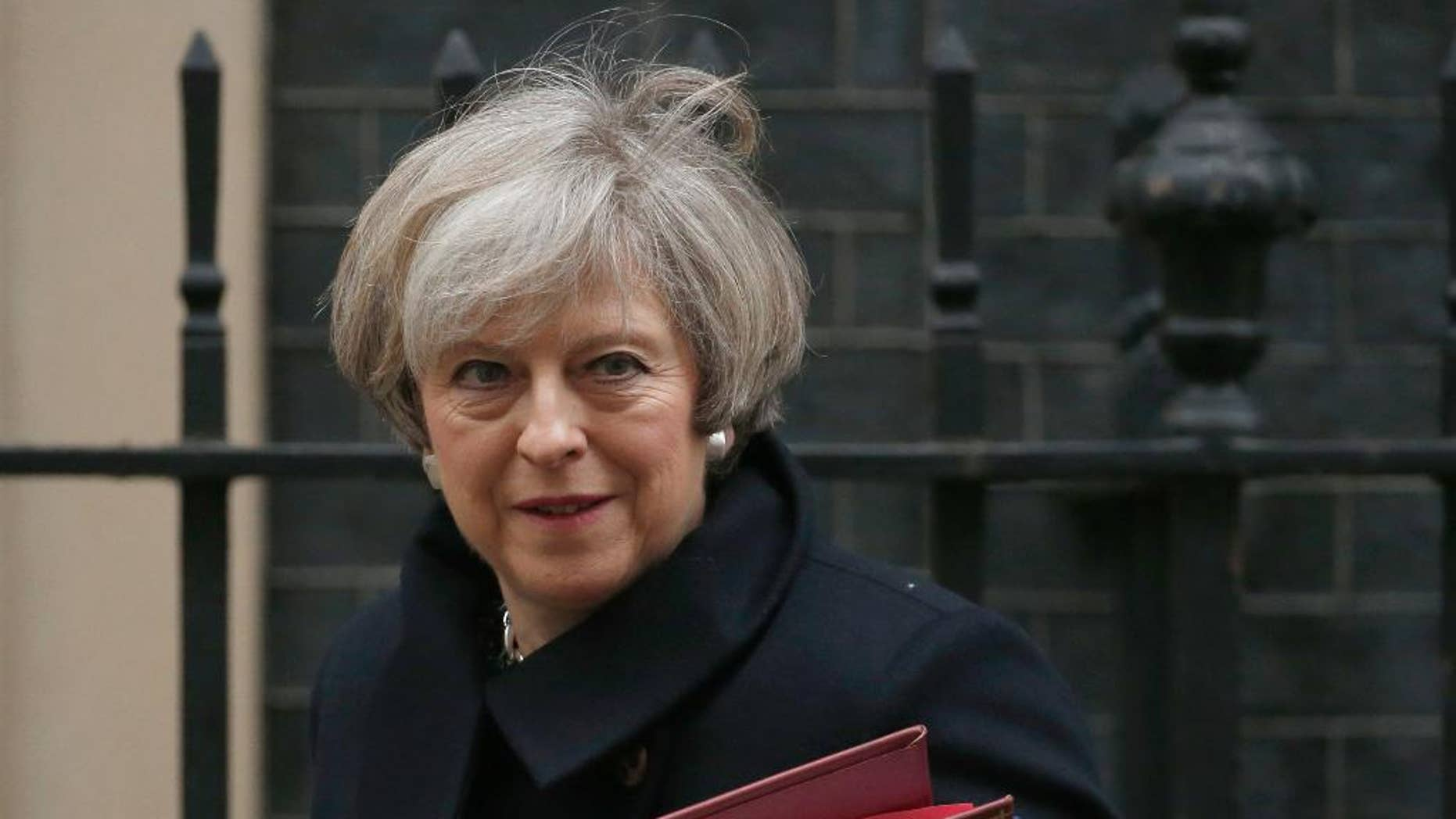 "Prime Minister Theresa May described her government's approach to refugees ""absolutely right."""