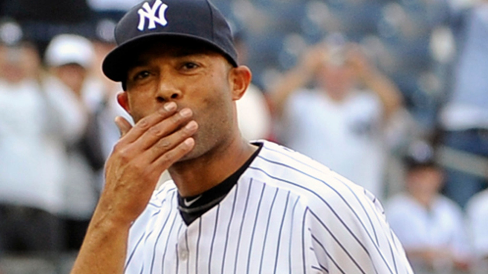 Sept 19: New York Yankees Mariano Rivera blows a kiss to the crowd to acknowledge cheers after recording his 602nd save as the Yankees beat the Minnesota Twins 6-4 at Yankee Stadium in New York.