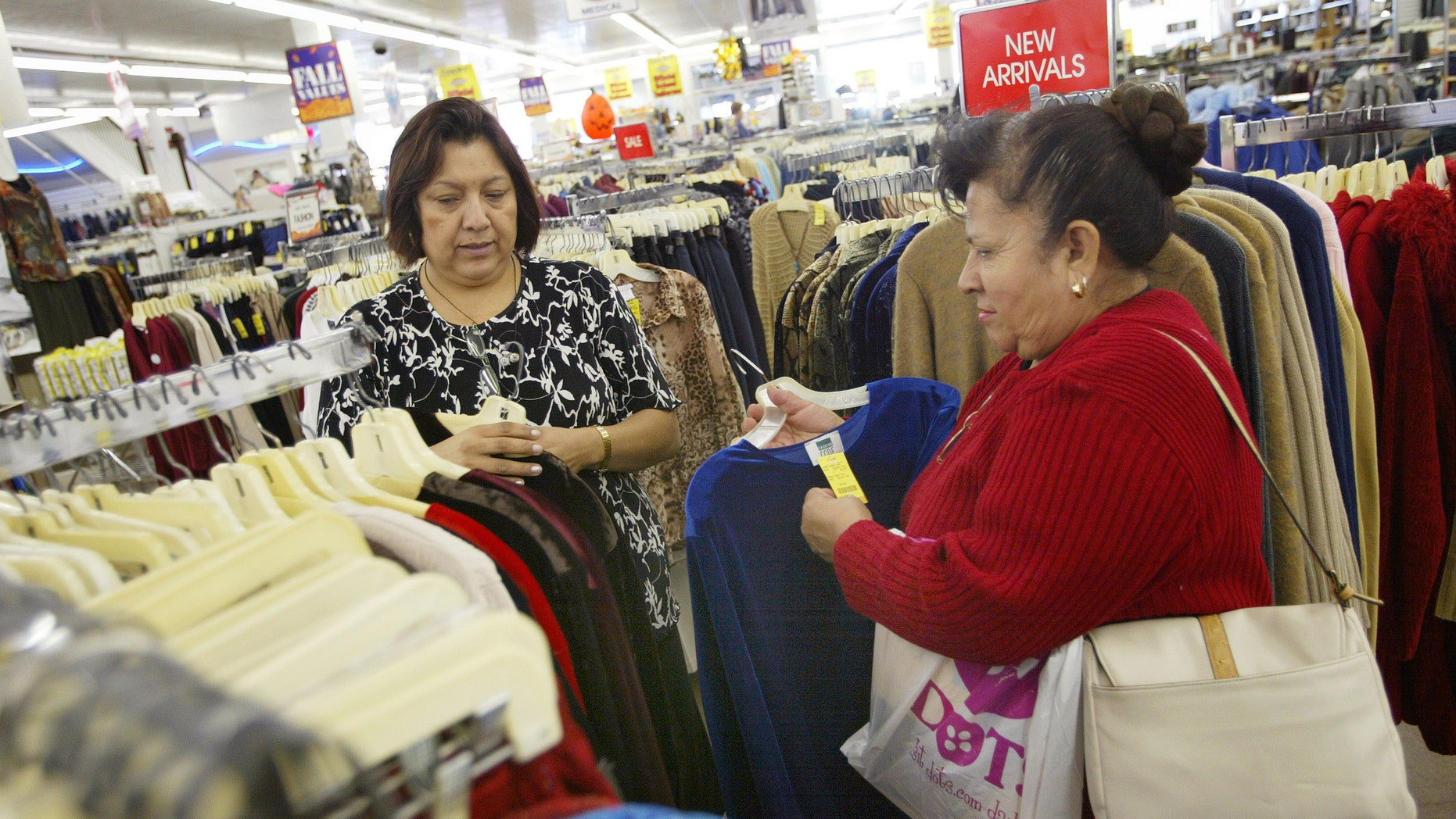 CHICAGO - OCTOBER 24:  Sales associate Maria Ayala (L) helps Carmen Anzo shop for clothing in a store located in Chicago's largely Hispanic Little Village neighborhood October 24, 2003 in Illinois. According to the U.S. Census Bureau, reports show that the nation's Hispanic population has grown to become the largest minority.  (Photo by Tim Boyle/Getty Images)