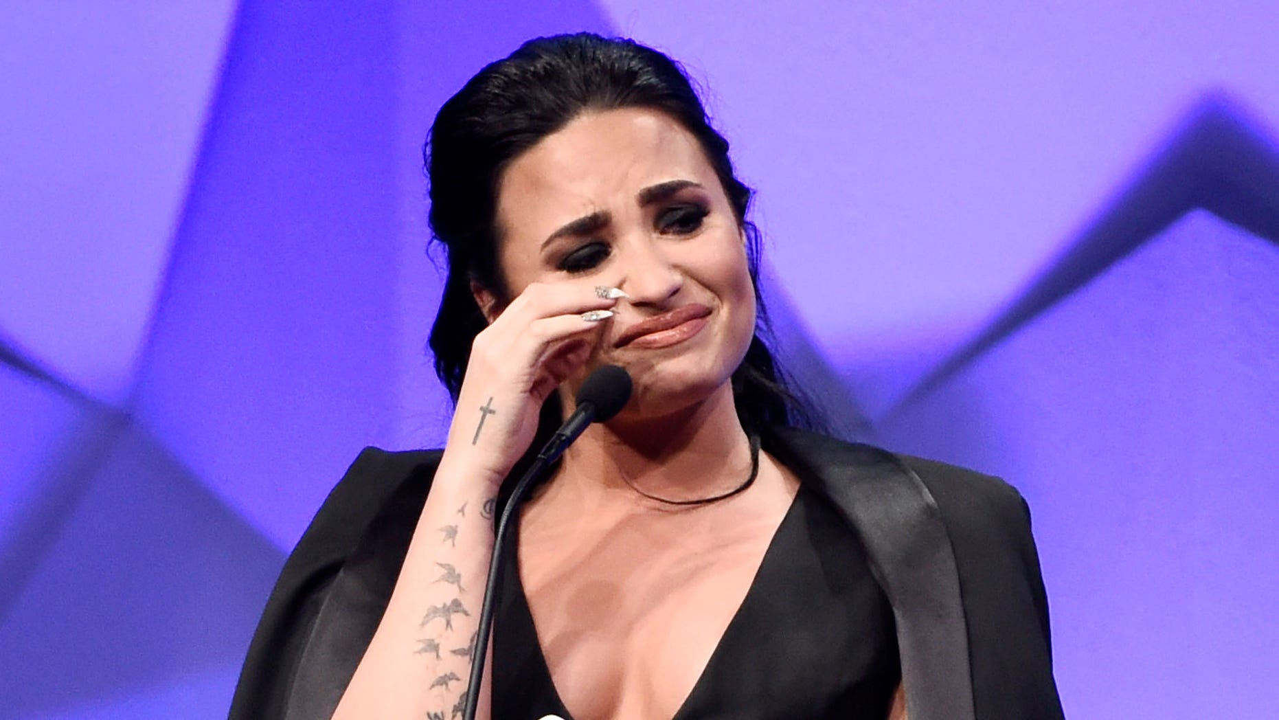 Singer Demi Lovato becomes emotional as she accepts the Vanguard Award during the 27th Annual GLAAD Media Awards at the Beverly Hilton on Saturday, April 2, 2016, in Beverly Hills, Calif. (Photo by Chris Pizzello/Invision/AP)