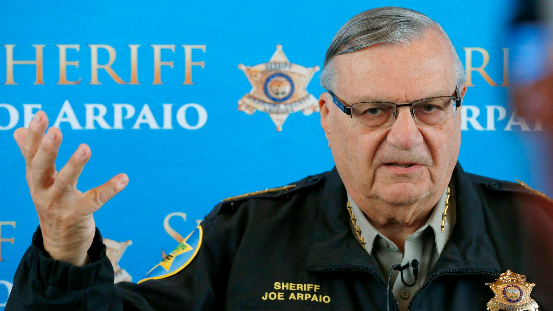 FILE - In this Dec. 18, 2013 file photo, Maricopa County Sheriff Joe Arpaio announces dozens of arrests in a prostitution sting during a news conference at Maricopa County Sheriff's Office Headquarters in Phoenix.   Arpaio, who has often clashed with the federal government over the enforcement of immigration laws has filed a lawsuit to stop new policies announced by President Barack Obama. The suit filed Thursday, Nov. 20, 2014 in federal court in Washington on behalf of Maricopa County Sheriff Joe Arpaio contends Obama acted outside his constitutional authority by not going through Congress.  (AP Photo/Ross D. Franklin)