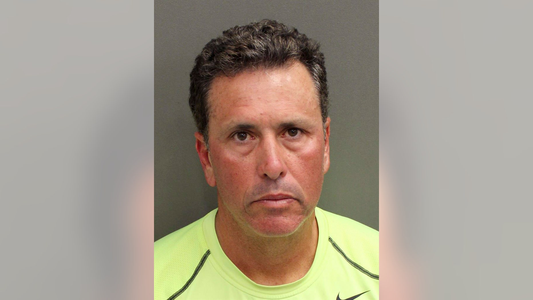 """FILE - This undated file photo provided by Orange County Corrections shows Gustavo Falcon, the last of South Florida's """"Cocaine Cowboys"""". Falcon was arrested Wednesday, April 12, 2017, some 26 years after he went on the lam, while on a 40-mile bike ride with his wife near the Orlando suburb where they apparently lived under assumed names. Falcon makes his first court appearance in Miami, Tuesday, April 25, 2017. (Orange County Corrections via AP, File)"""