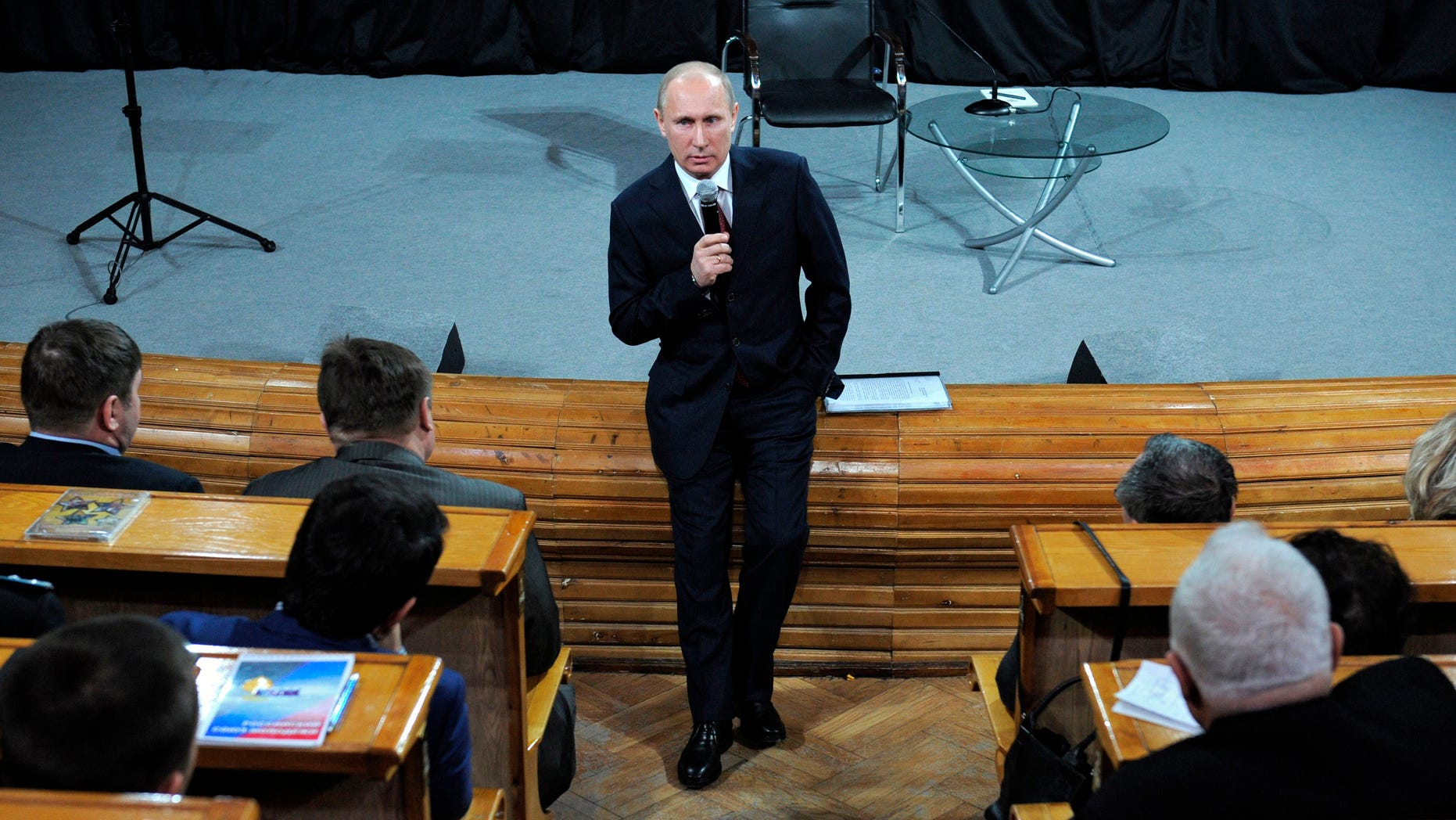 Feb. 7, 2012: Russian Prime Minister and presidential candidate Vladimir Putin addresses election activists in Moscow.