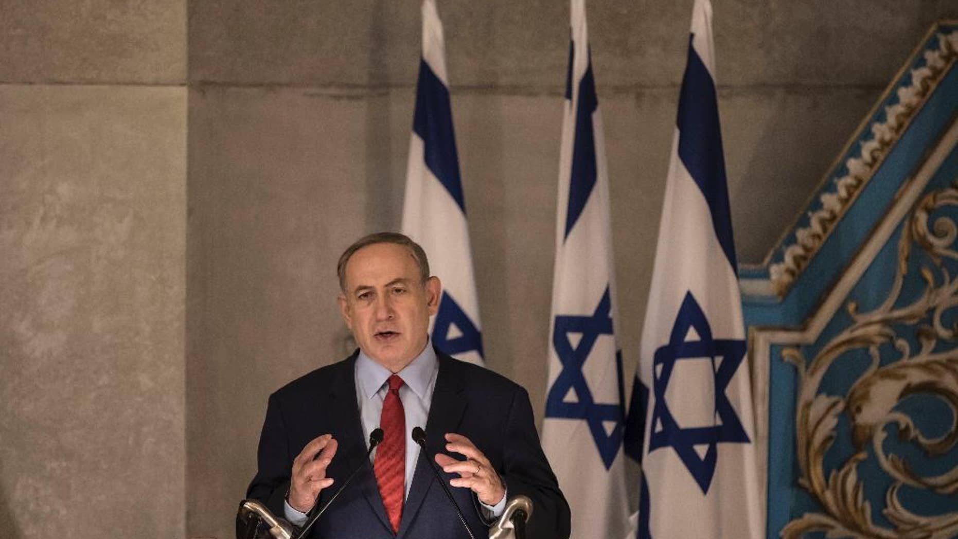 """Israeli Prime Minister Benjamin Netanyahu speaks in the synagogue at the Yad Vashem Holocaust Memorial Museum, in Jerusalem, Thursday, Jan. 26, 2017. In remarks at the Holocaust ceremony on Thursday, Netanyahu said President Donald Trump understands the """"danger"""" stemming from the Iran nuclear deal. (AP Photo/Tsafrir Abayov)"""