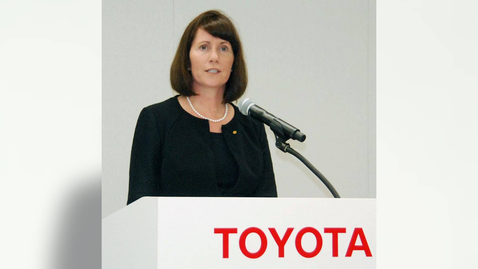 Julie Hamp, Toyota Motor Corp.'s new head of public relations, speaks during a press conference in Toyota, central Japan, Wednesday, June 17, 2015.  Hamp was arrested Thursday, June 18,  on suspicion of importing an illegal pain medicine into Japan, Tokyo police said.  Hamp, an American, was appointed in April as Toyota's first female top executive. She had been moving her things to Japan from California, where she had been head of communications for Toyota's U.S. operations.  (Kyodo News via AP) JAPAN OUT, CREDIT MANDATORY