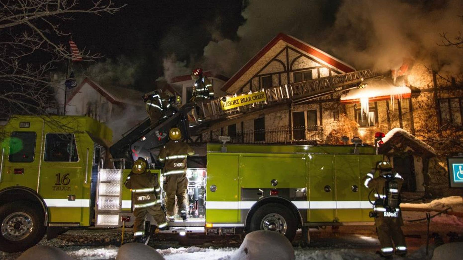 """Firefighters extinguish a blaze Sunday, Dec. 11, 2016, at Boyne Highlands Resort in Harbor Springs, Mich. The resort called it a """"significant structure fire"""" early Sunday.  (Alex Childress Photo via AP)"""