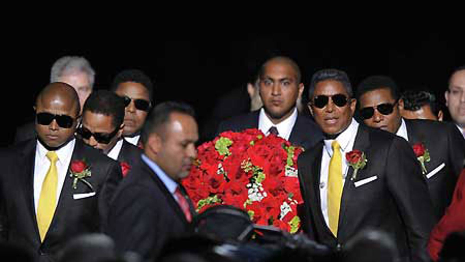 July 7: Michael Jackson's brothers carry his casket to a stage in the Staples Center for the singer's public memorial.
