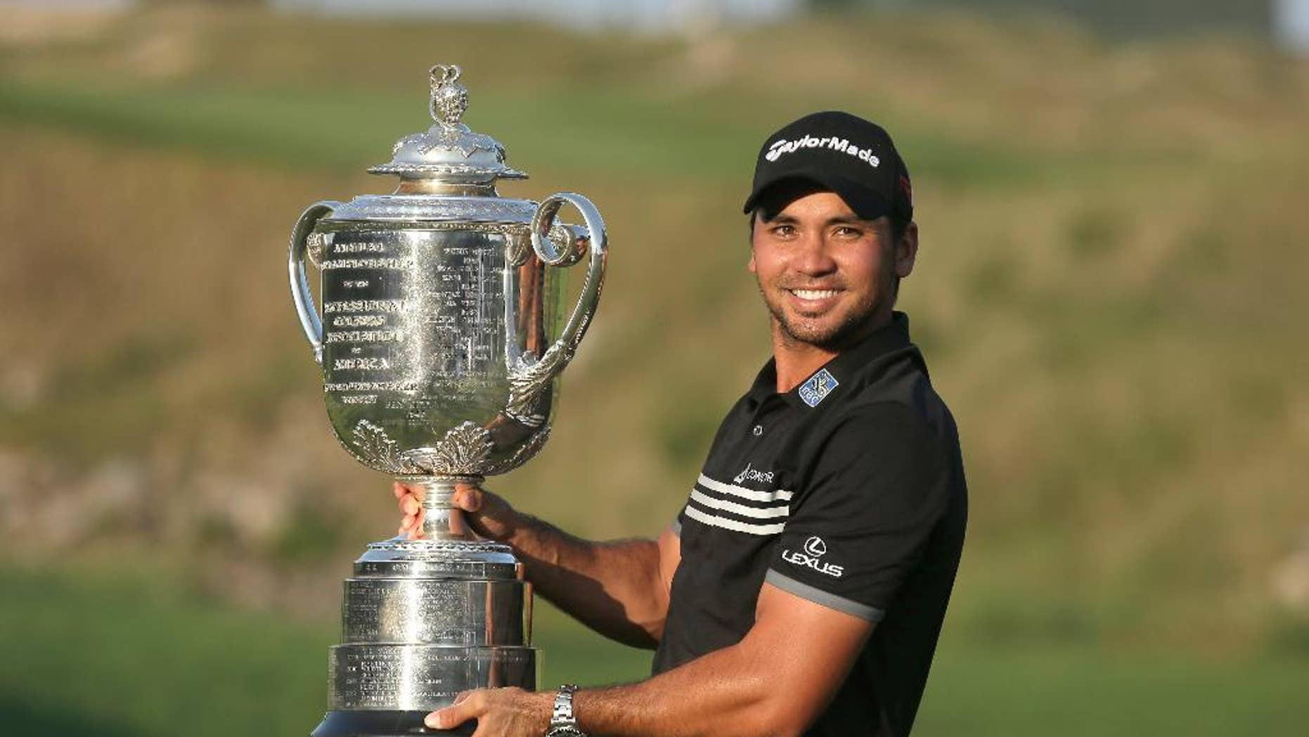 Jason Day, of Australia, holds up the Wanamaker Trophy after winning the PGA Championship golf tournament Sunday, Aug. 16, 2015, at Whistling Straits in Haven, Wis. (AP Photo/Chris Carlson)
