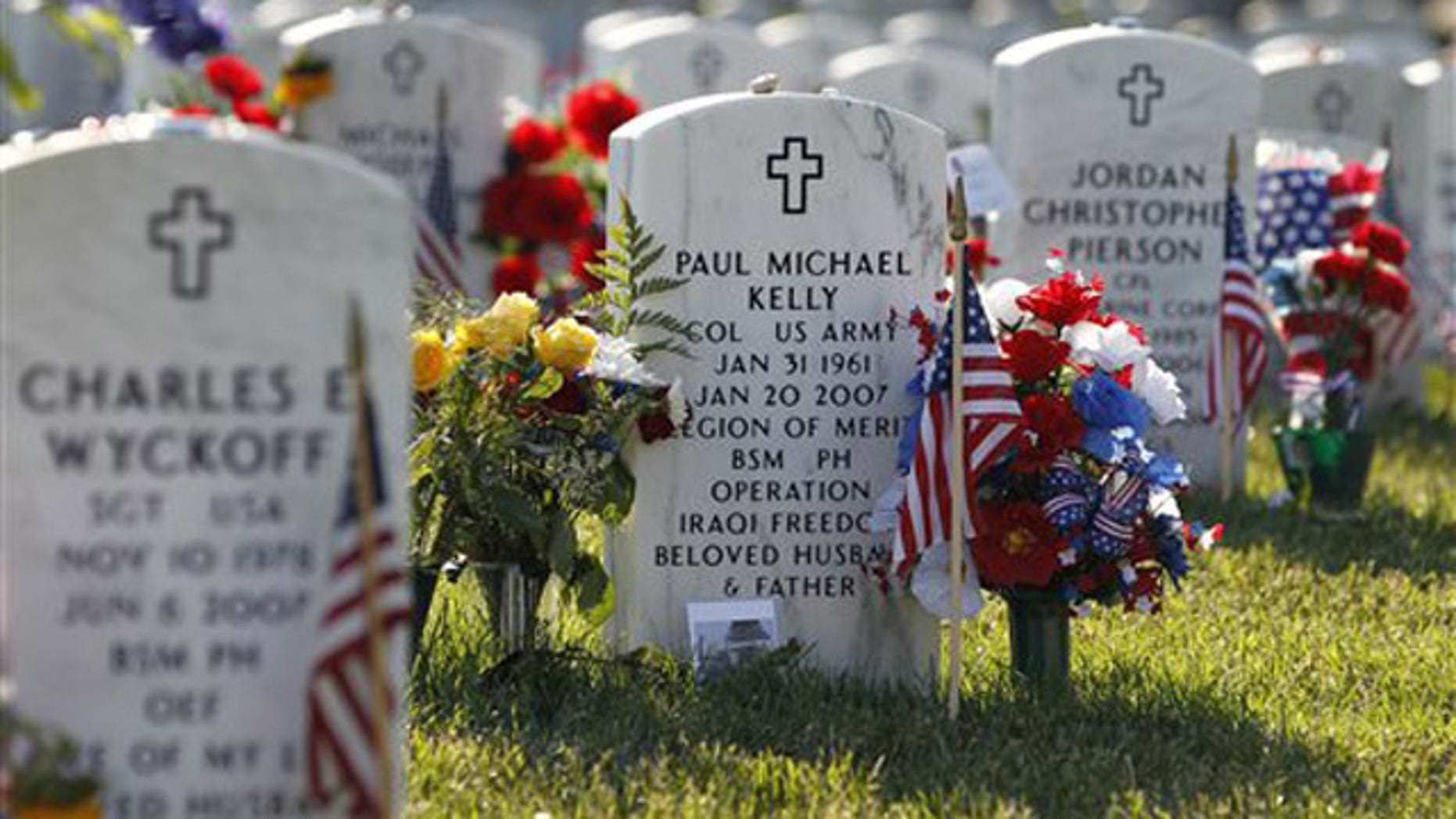 The headstone of Army Col. Paul Michael Kelly is seen at Arlington National Cemetery in Arlington, Va., where one lawmaker estimates up to 6,600 graves have been unmarked or improperly labeled.