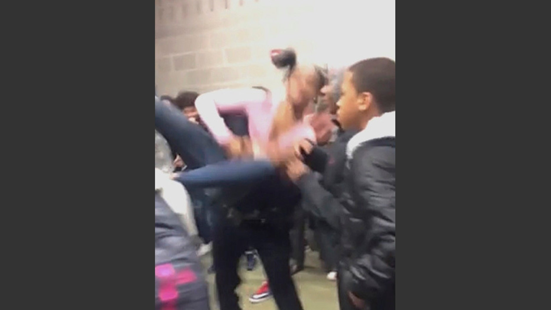 In this Tuesday, Jan. 3, 2017, image made from video and released by Pam C. Akpuda, officer Ruben De Los Santos of the Rolesville Police Department slams a teenage girl to the floor in Rolesville, N.C. The student who was slammed to the ground by a police officer was trying to break up a fight involving her sister, said the 15-year-old who posted video of the incident. (Pam C. Akpuda via AP)