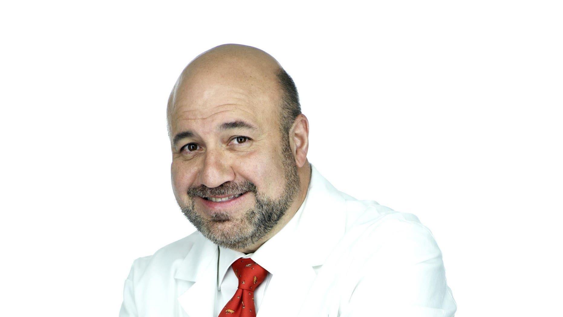 Dr. Manny Alvarez