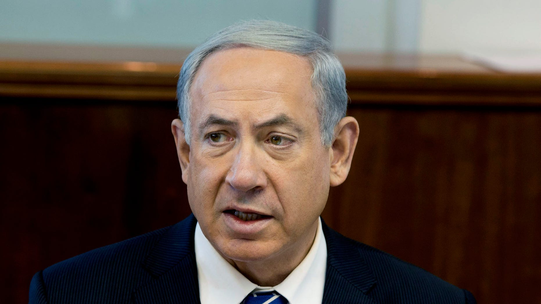 Israel's Prime Minister Benjamin Netanyahu speaks during the weekly cabinet meeting in Jerusalem, Sunday, Jan. 19, 2014. (AP Photo/Ilia Yefimovich, Pool)