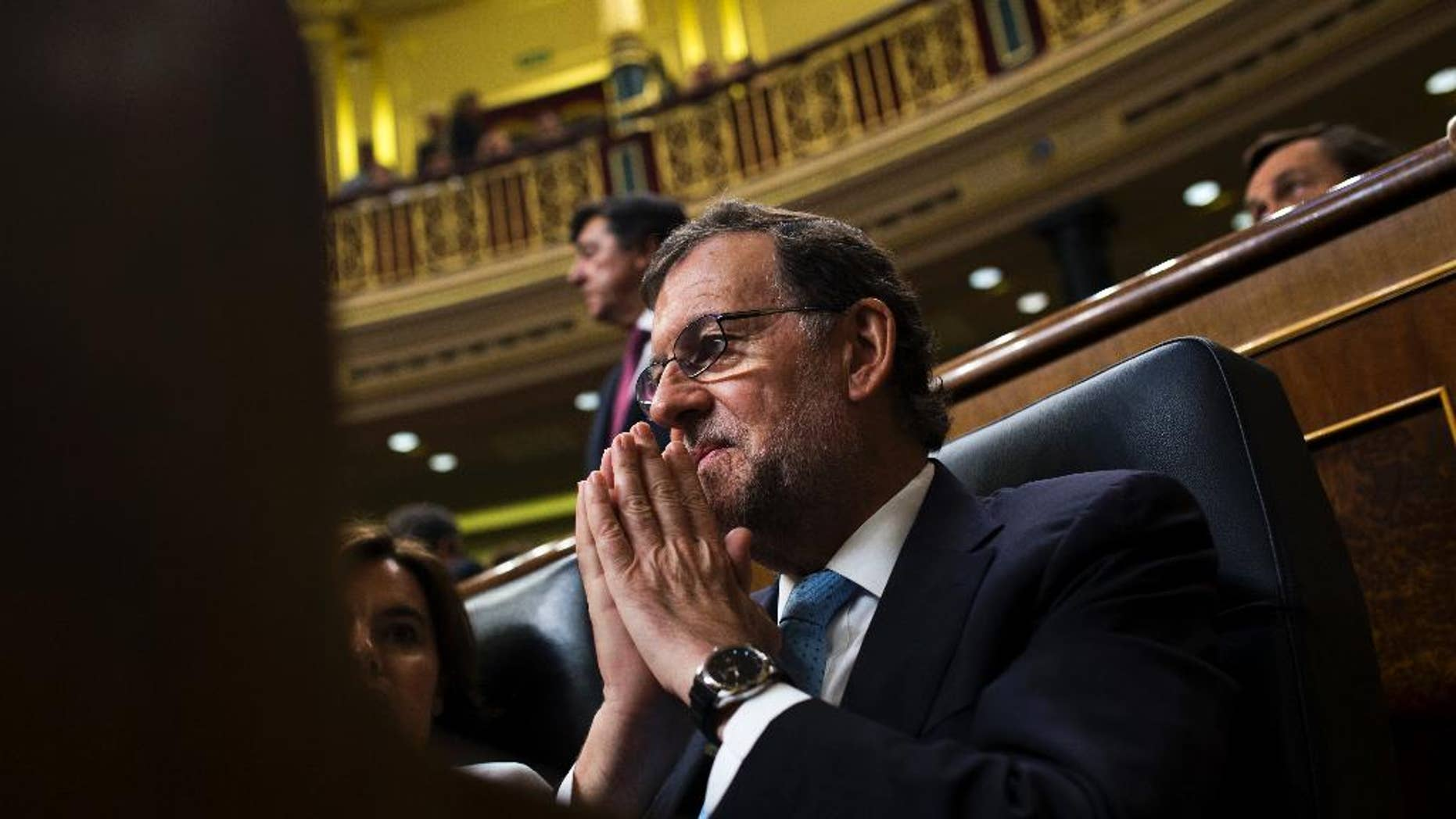 """FILE - In this July 19, 2016 file photo, Spain's acting Prime Minister Mariano Rajoy attends the Spanish parliament in Madrid. Spain's acting Prime Minister Mariano Rajoy warned on Saturday Aug. 13, 2016 that a third round of elections in one year would make Spain """"the laughingstock of Europe"""" as he tries to cobble together support to form a government and end eight months of political deadlock. (AP Photo/Francisco Seco, FILE)"""