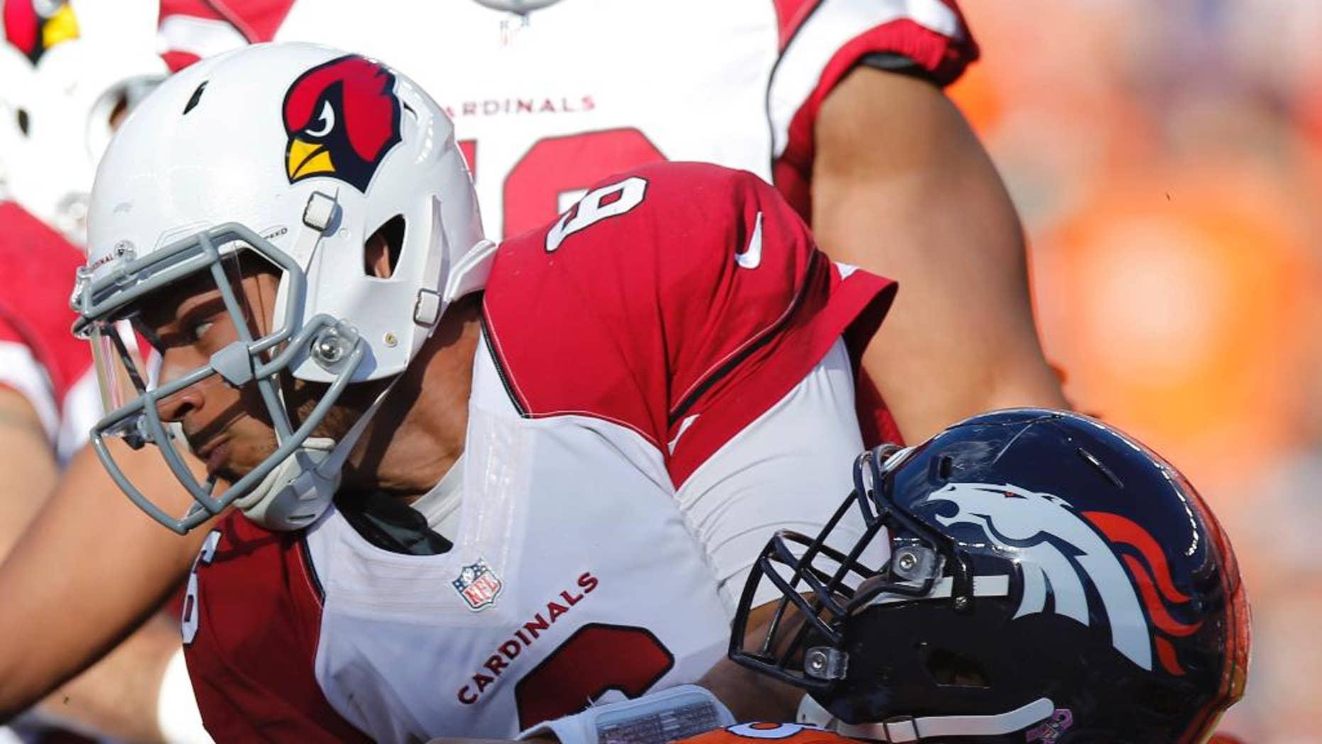 Arizona Cardinals quarterback Logan Thomas is sacked by Denver Broncos outside linebacker Von Miller (58) during the second half of an NFL football game, Sunday, Oct. 5, 2014, in Denver. (AP Photo/David Zalubowski)