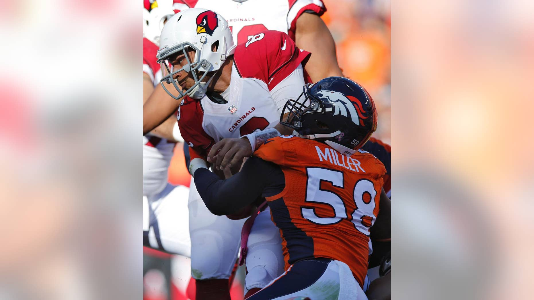 Arizona Cardinals quarterback Logan Thomas is sacked by Denver Broncos outside linebacker Von Miller (58) during the second half of an NFL football game, Sunday, Oct. 5, 2014, in Denver. (AP Photo/David Zalubowski)
