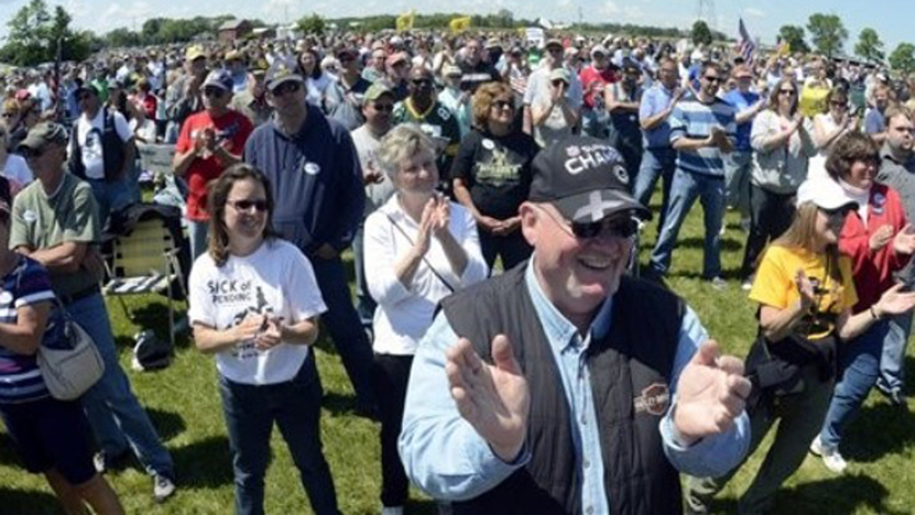 FILE: June 2, 2012: Spectators applaud at a rally held by the Racine Tea Party PAC in Gorney Park in Caledonia, Wis.