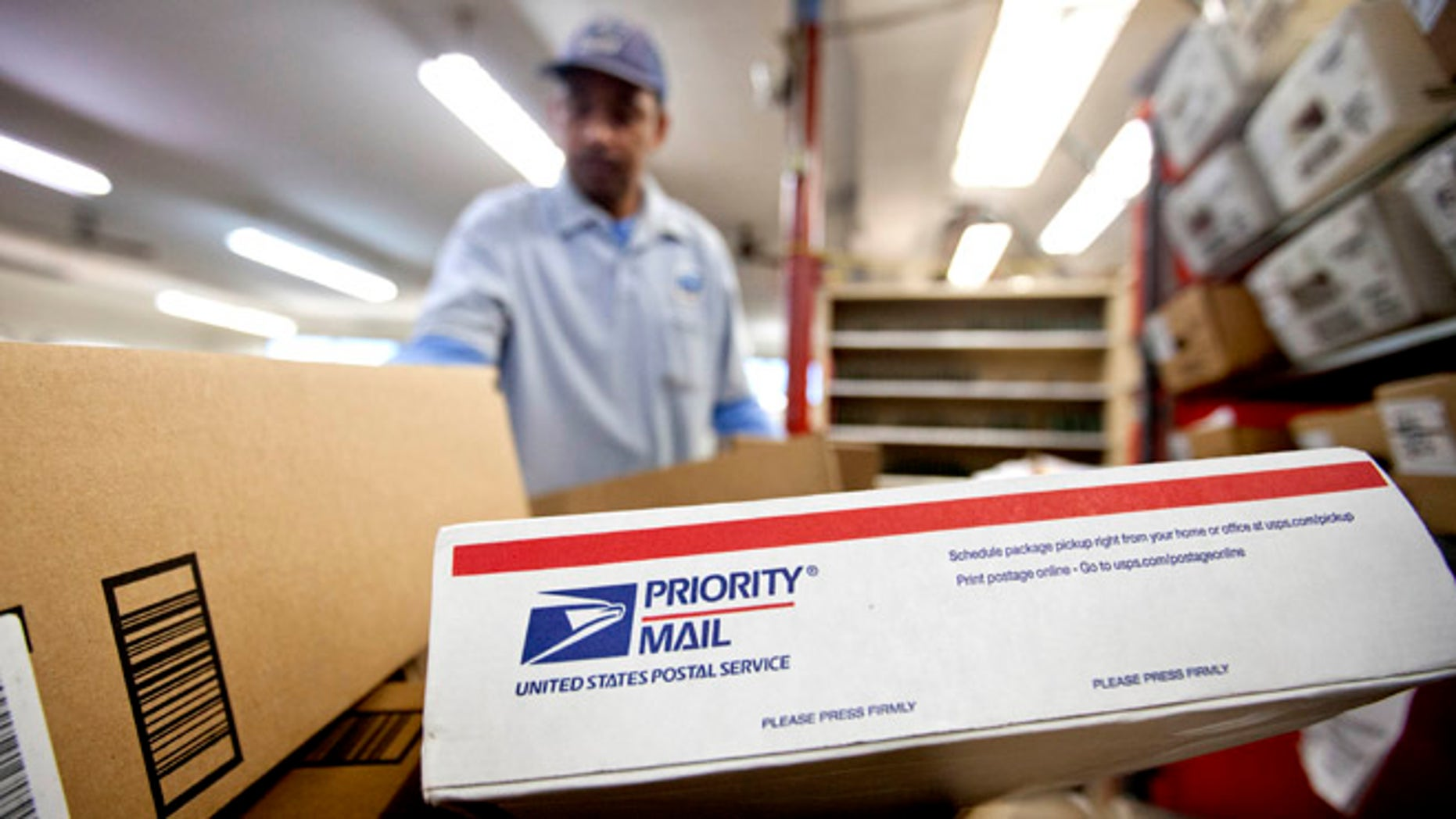 Feb. 7, 2013: In this file photo, packages wait to be sorted in a Post Office as U.S. Postal Service letter carrier  Michael McDonald, gathers mail to load into his truck before making his delivery run, in Atlanta.