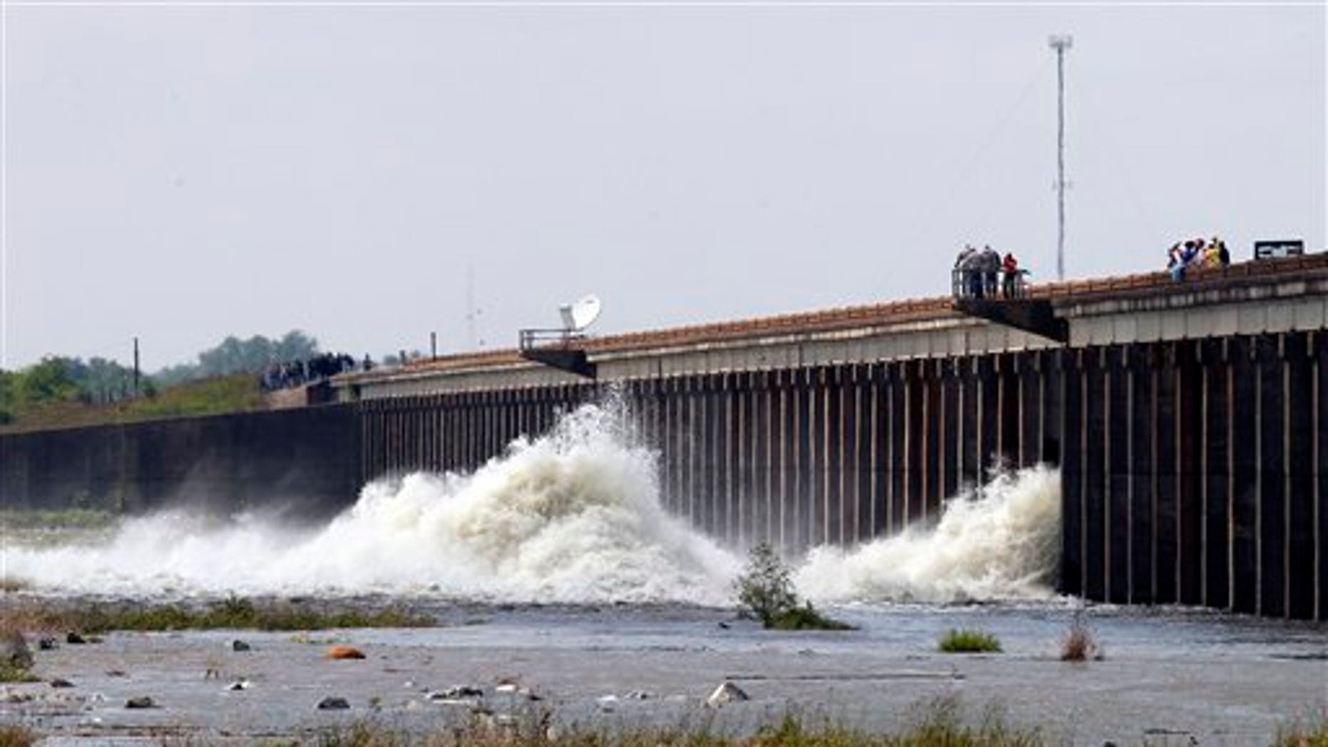 May 14: Water diverted from the Mississippi River spills through a bay in the Morganza Spillway in Morganza, La. A steel, 10-ton floodgate was slowly raised Saturday for the first time in nearly four decades, unleashing a torrent of water from the Mississippi River, away from heavily populated areas downstream. (AP)