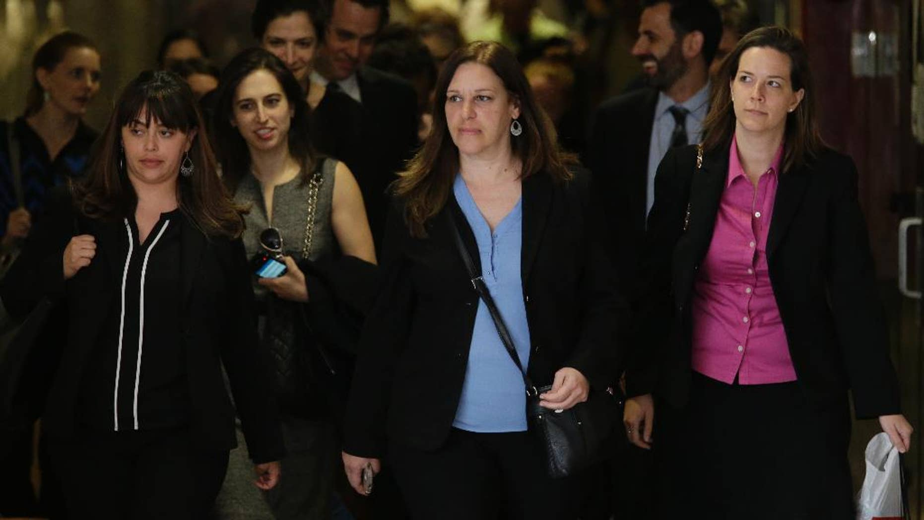 Assistant District Attorney Joan Illuzzi-Orbon, center, leaves at the end of the day in the trial of Pedro Hernandez in New York, Tuesday, May 5, 2015, in New York. Jurors deliberating in the murder trial of Hernandez, a man accused of kidnapping and killing 6-year-old Etan Patz in 1979, said they're deadlocked — for a second time. But a judge is telling them to keep trying for a verdict. (AP Photo/Mary Altaffer)