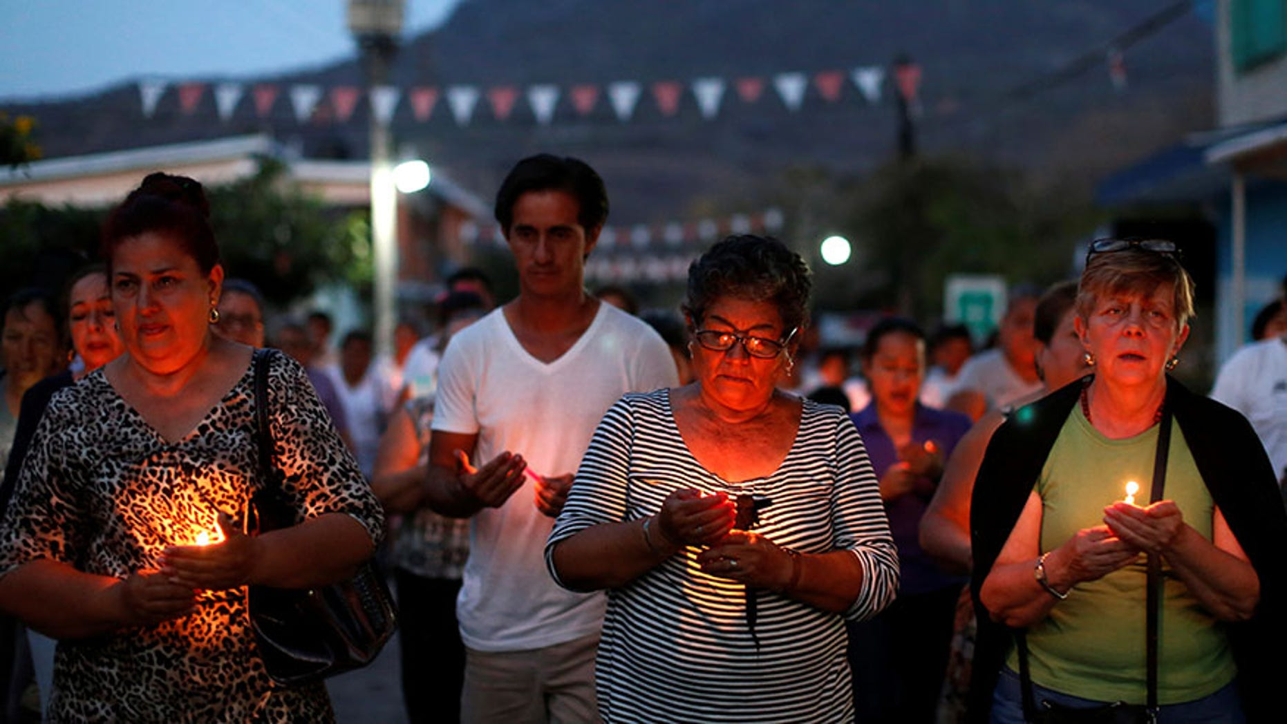Mothers of missing sons come out of a service of Pedro Alberto Huesca, whose remains were found at one of the unmarked graves in Palmas de Abajo, Veracruz, Mexico on March 16, 2017.