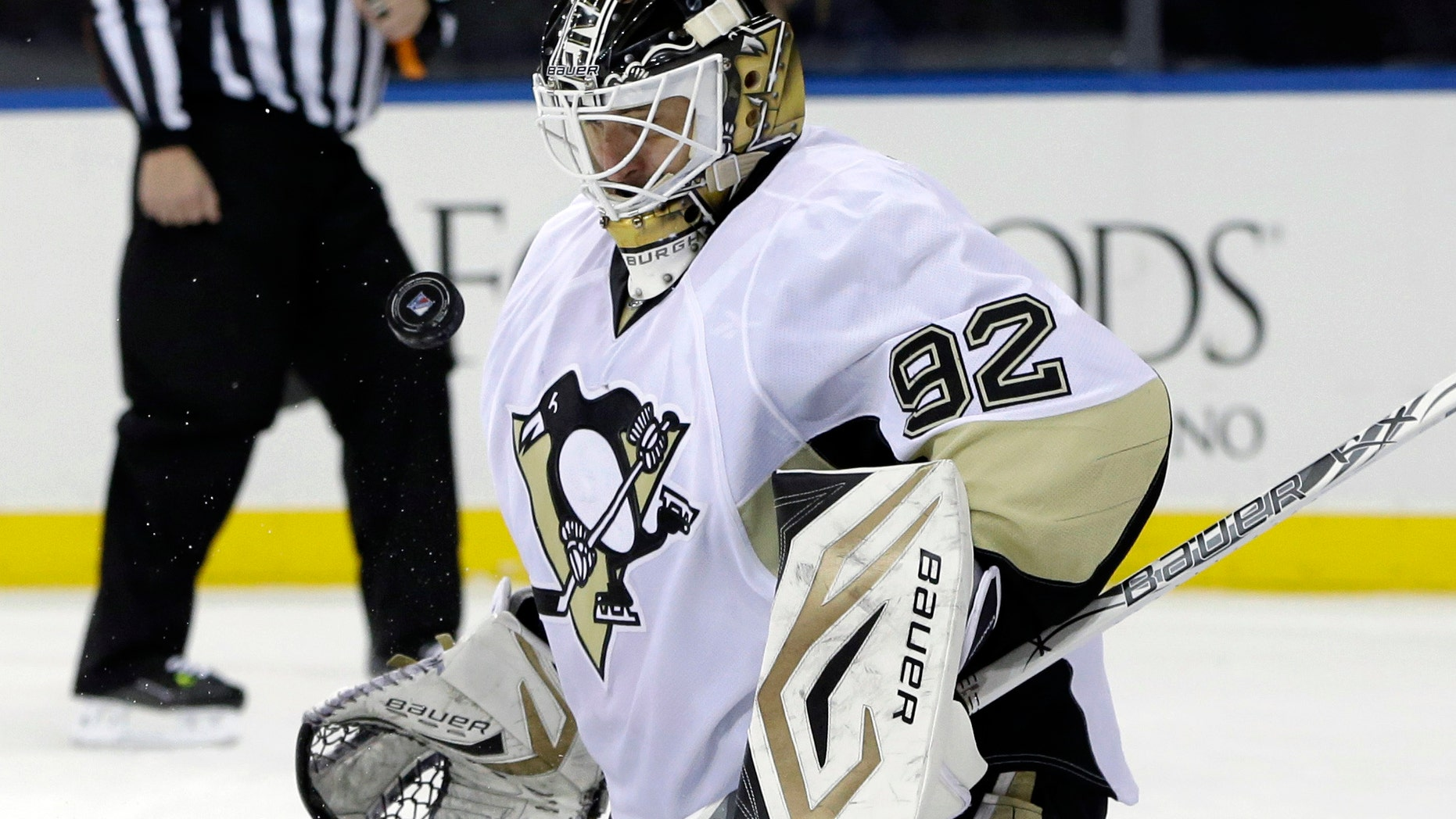 Pittsburgh Penguins goalie Tomas Vokoun (92), of Czech Republic, makes a save in the second period of their NHL hockey game against the New York Rangers in New York, Thursday, Jan. 31, 2013. The Penguins shutout the Rangers 3-0. (AP Photo/Kathy Willens