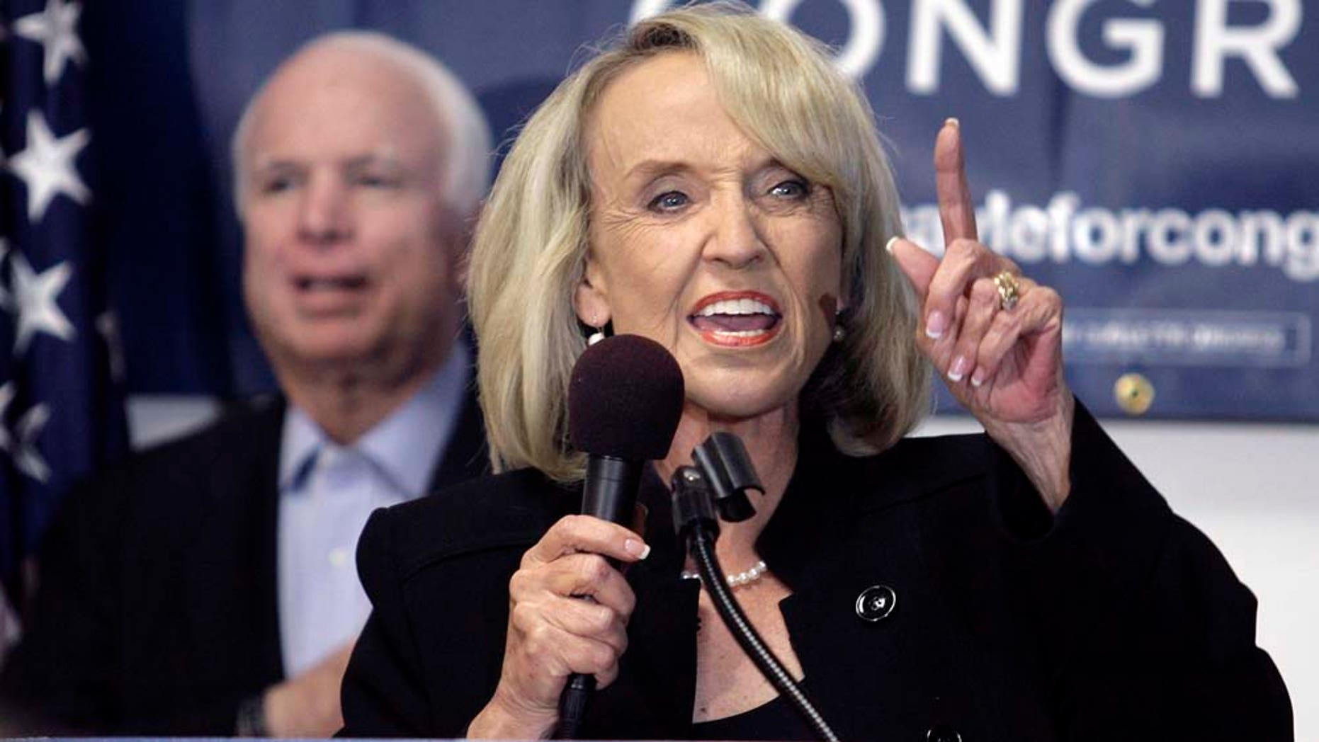 Gov. Jan Brewer, right ,addresses a group of supporters as Sen. John McCain, (R-Ariz.), left, cheers during a rally for Republican Congressional candidate Ben Quayle, at Quayle's campaign headquarters Saturday, Oct. 30, 2010, in Phoenix. (AP Photo/Paul Connors)