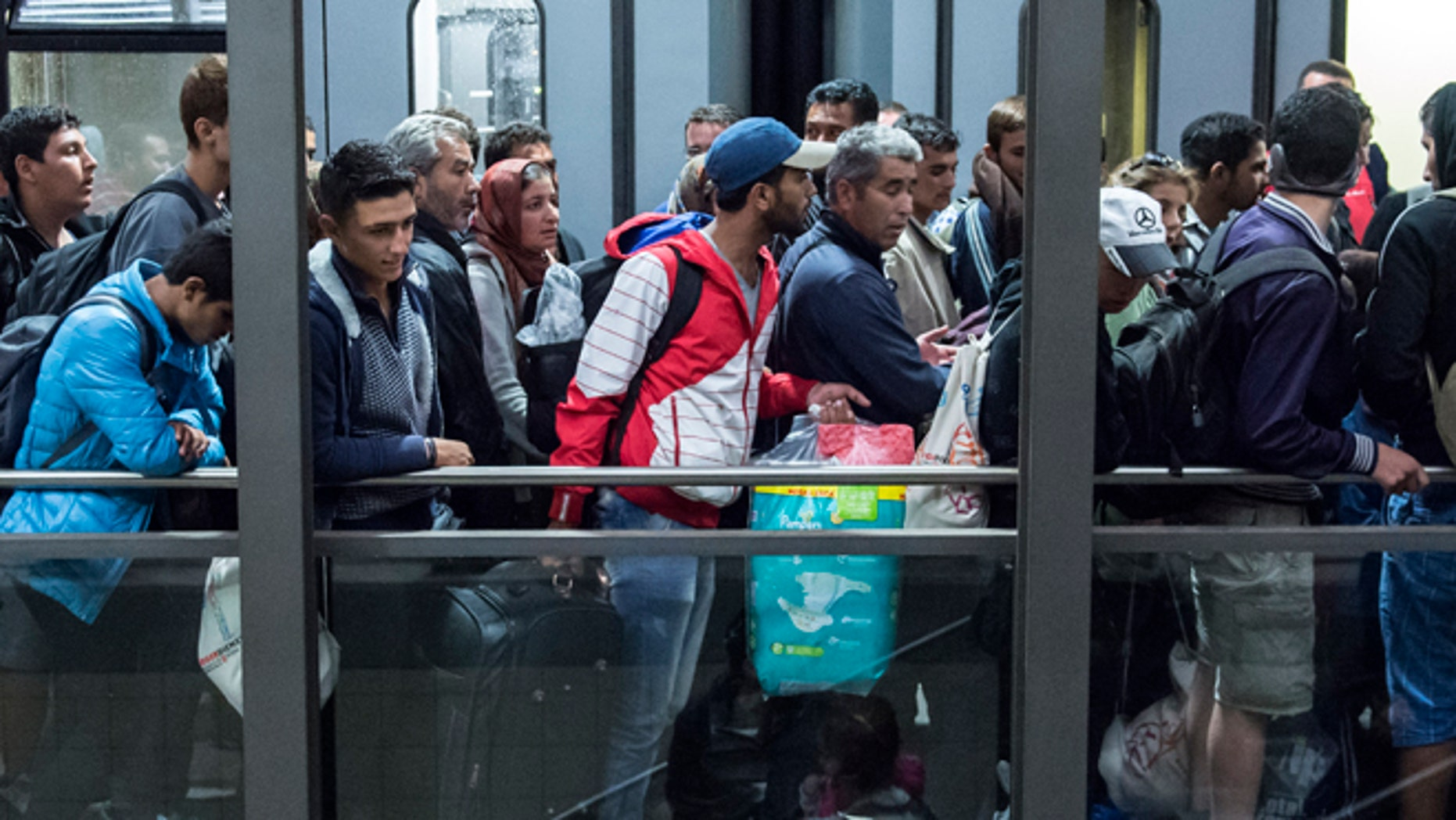 Sept. 5, 2015: Refugees arrive at the train station in Saalfeld, central Germany. Hundreds of refugees arrived in a train from Munich to be transported by buses to an accommodation center.