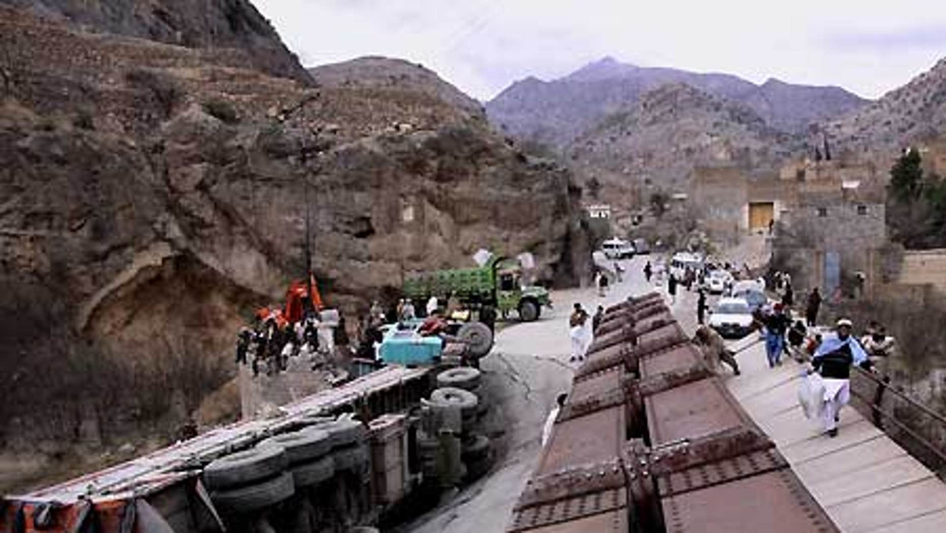 Feb. 3: A truck lies down on a bridge destroyed by alleged Islamic militants in the Pakistani tribal area of Khyber.