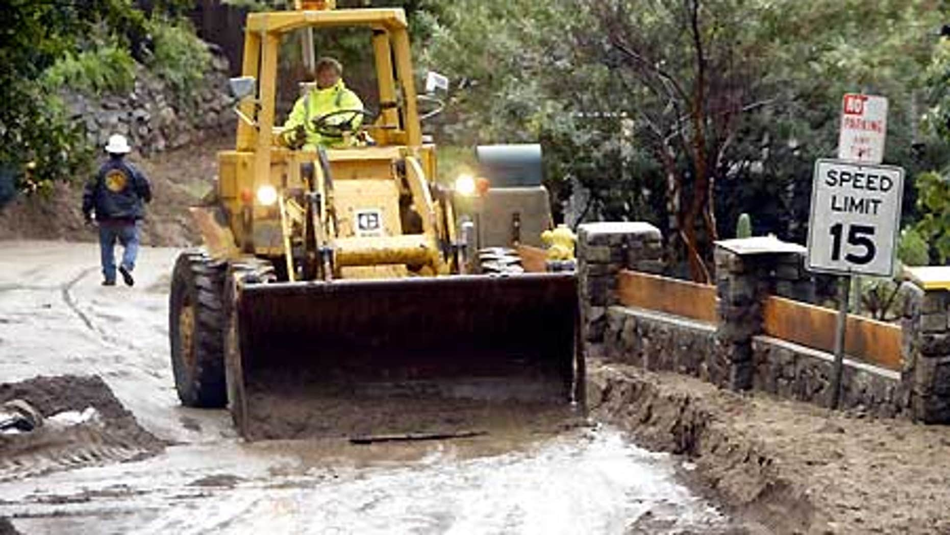Feb. 7: Heavy equipment removes mudflow on Woodland Drive in Sierra Madre, Calif.