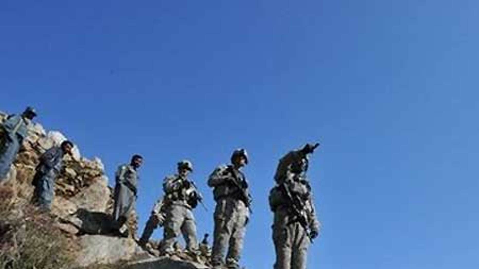 Feb. 17: U.S. troops patrol at Tag in Laghman. Pakistan has confirmed the capture of the Taliban's top military commander Mullah Abdul Ghani Baradar.