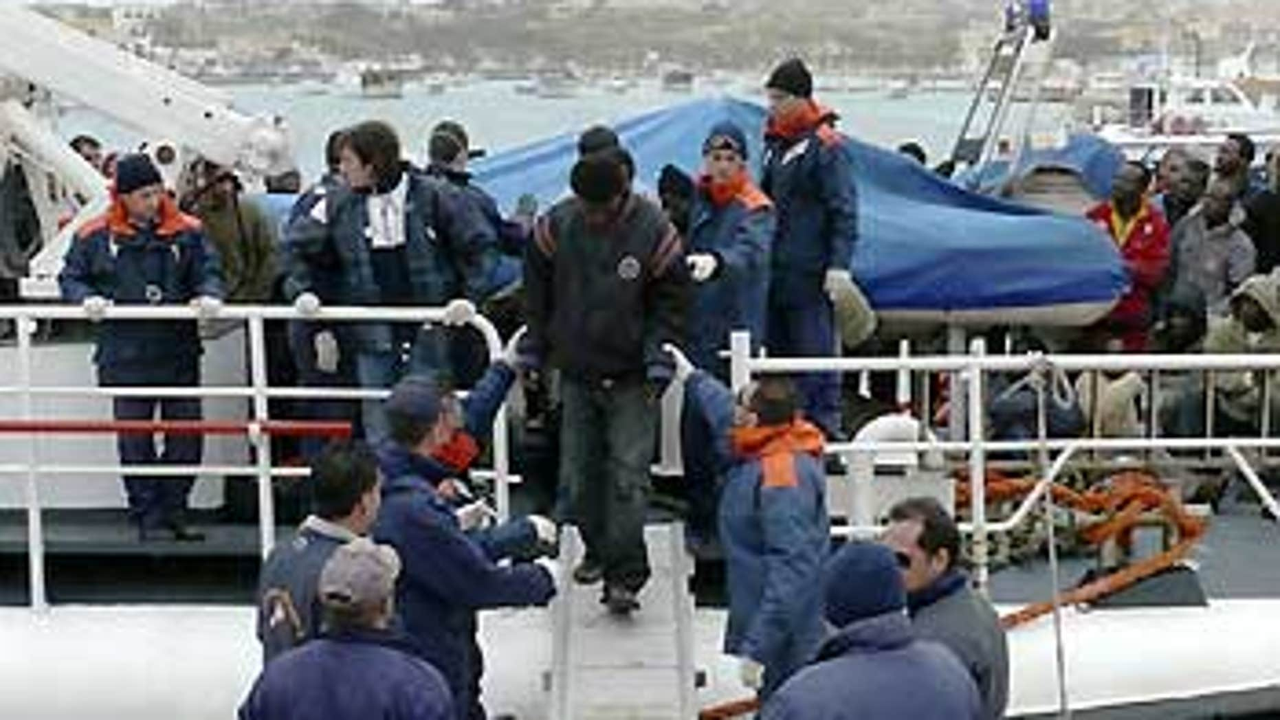March 29: An Italian Coast Guard boat carrying some would-be immigrants, rescued at sea, reaches the port of the tiny Italian island of Lampedusa.